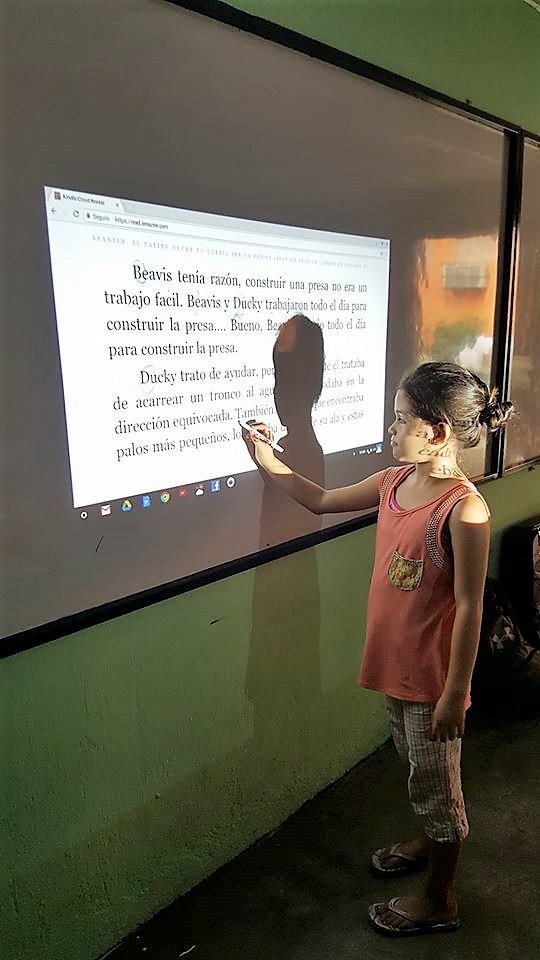 Adding punctuation, and teaching her classmates while learning.