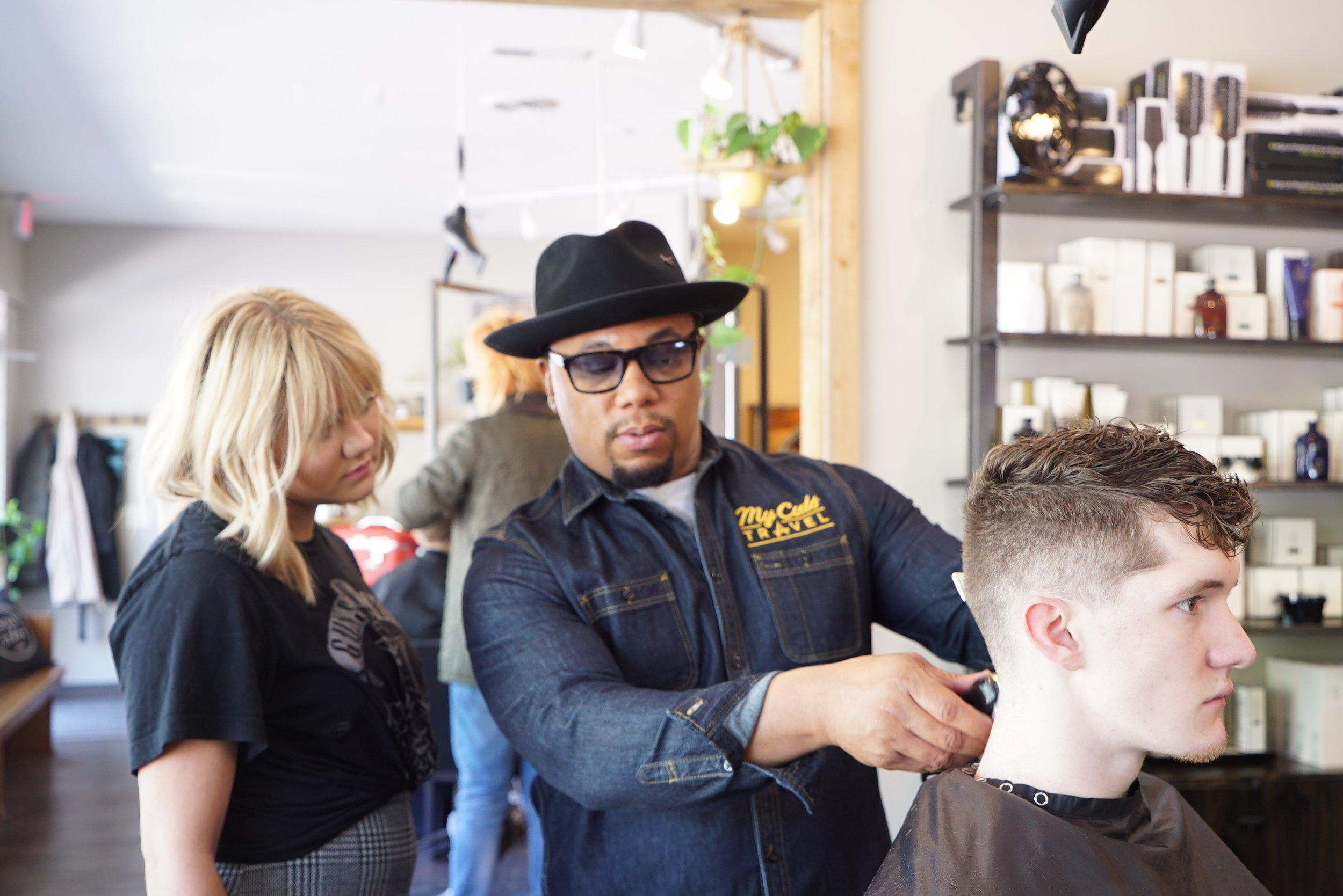 """Tahki teaching salon professionals at Paisley and Stripe in Lawrence  """"Tahki broke down barbering in a way that was empowering and easy to understand. My staff thanked me several times for bringing him in. I would highly reccomend him to all salon professionals wanting to go to the next level with thier male clientele.""""  -Penny Stuckel, Owner of Paisley and Stripe   TAHKI""""S INSTAGRAM    MY CUTS TRAVEL"""