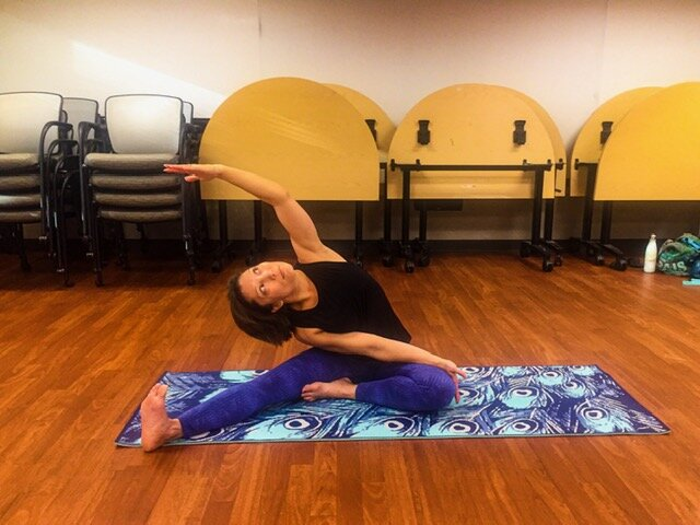 "Pavritta Konasa - I have no delusions of being able to grab my foot with my top hand, and that's completely OK. This is  my "" full expression"" of the pose at the moment."