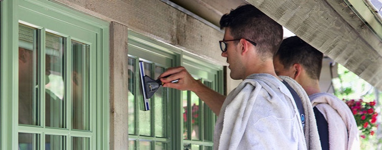 We Clean Windows By Hand -