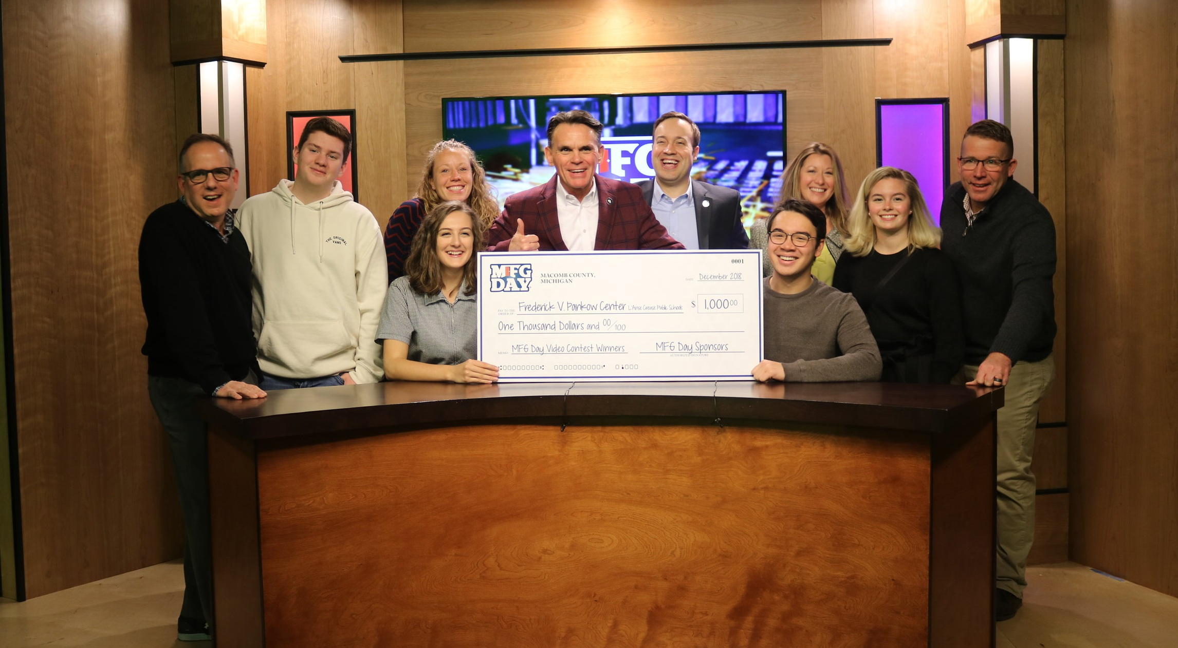 The winning team of lauren bayless, angel delich, jack braithwaite and jacob ashba with macomb county executive mark hackel and other macomb county leaders
