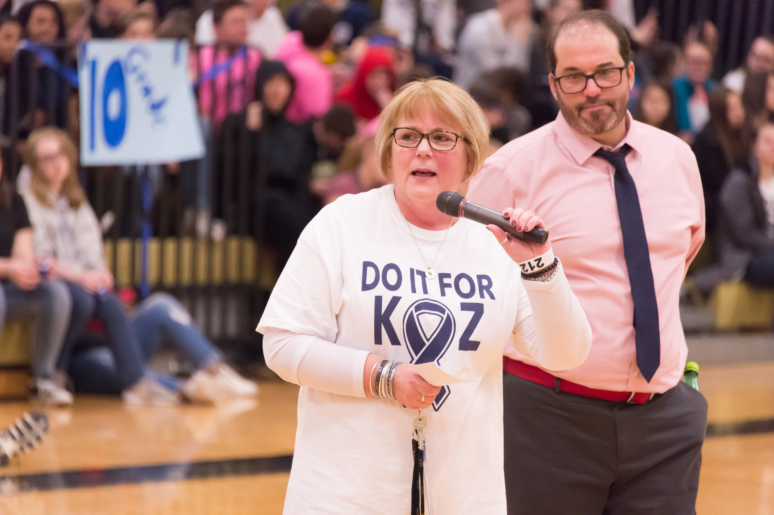 kitty reifert speaks about kozian during a charity week assembly
