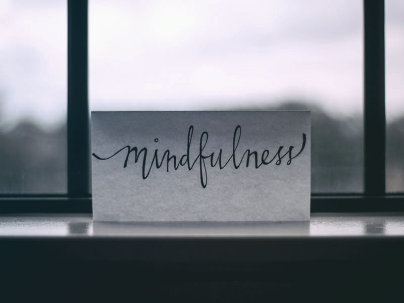 "Mindfulness - Mindfulness is the practice of bringing your attention to the present moment, in order to bring yourself back to reality. The phrase ""be present"" refers to mindfulness and what it's all about, and mindfulness is a great tool for those who have experienced trauma or experience re-traumatization.In therapy, mindfulness is often practiced via ""grounding"", which is a technique that incorporates your physical surroundings in order to bring your attention to the present moment. This can be especially effective for people who find themselves experiencing flashbacks or anxiety.PRACTICE THE RULE OF FIVE:Identify five things you see: ""I see a bird, I see my shoes, etc.""Identify five things you smell: ""I smell leaves, I smell perfume, etc.""Identify five things you hear: ""I hear traffic, I hear talking, etc.""Identify five things you feel: ""I feel my shirt, I feel my hands, etc."""