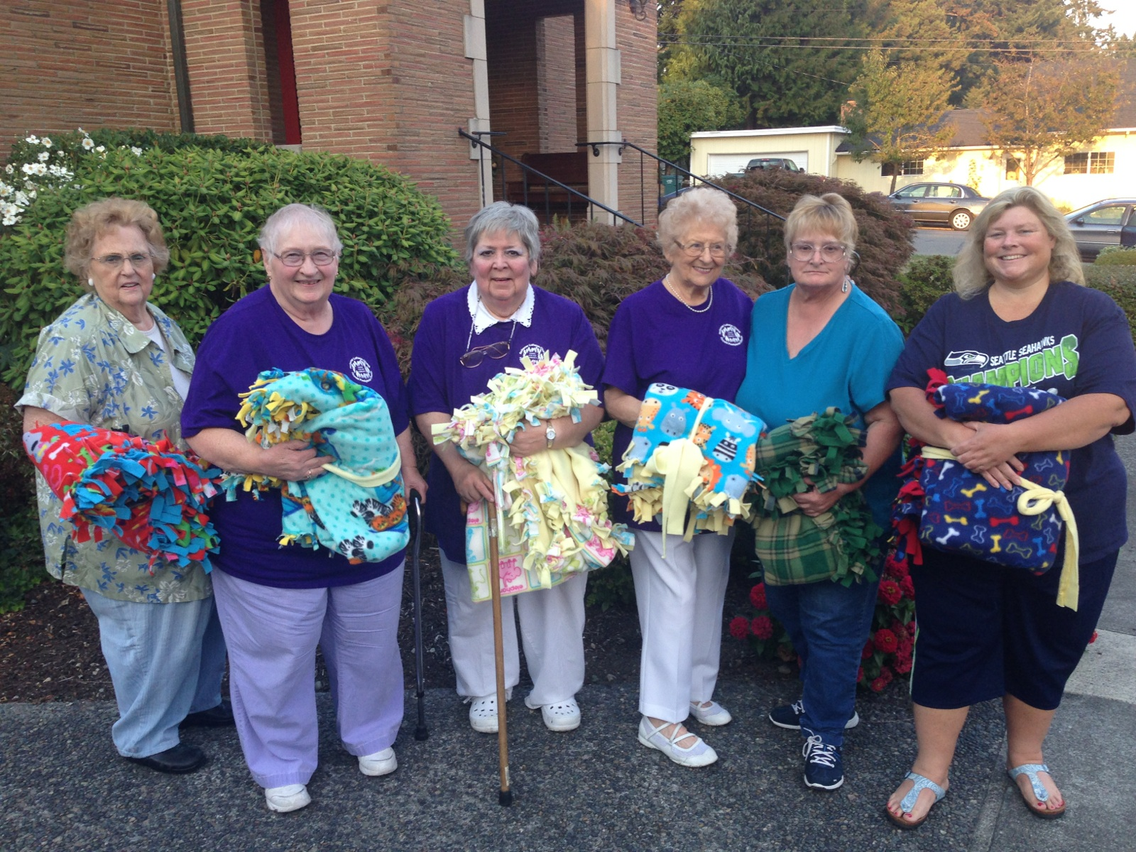 September - The Knotty Ladies, Fircrest Presbyterian & Redeemer Lutheran ChurchThe Knotty Ladies, who frequently donate handmade baby blankets to Step By Step, called our office to ask if they could include us in their churches' weekend of service event. On Sunday evening, September 21st, Cheryl and Sarah from Step By Step were honored to receive not only a new donation of beautiful blankets, but also diapers, baby wipes, formula and baby food that the two churches had gathered to donate to us. Thank you for your heartfelt generosity and your continued support of Step By Step and the many moms and babies we serve!