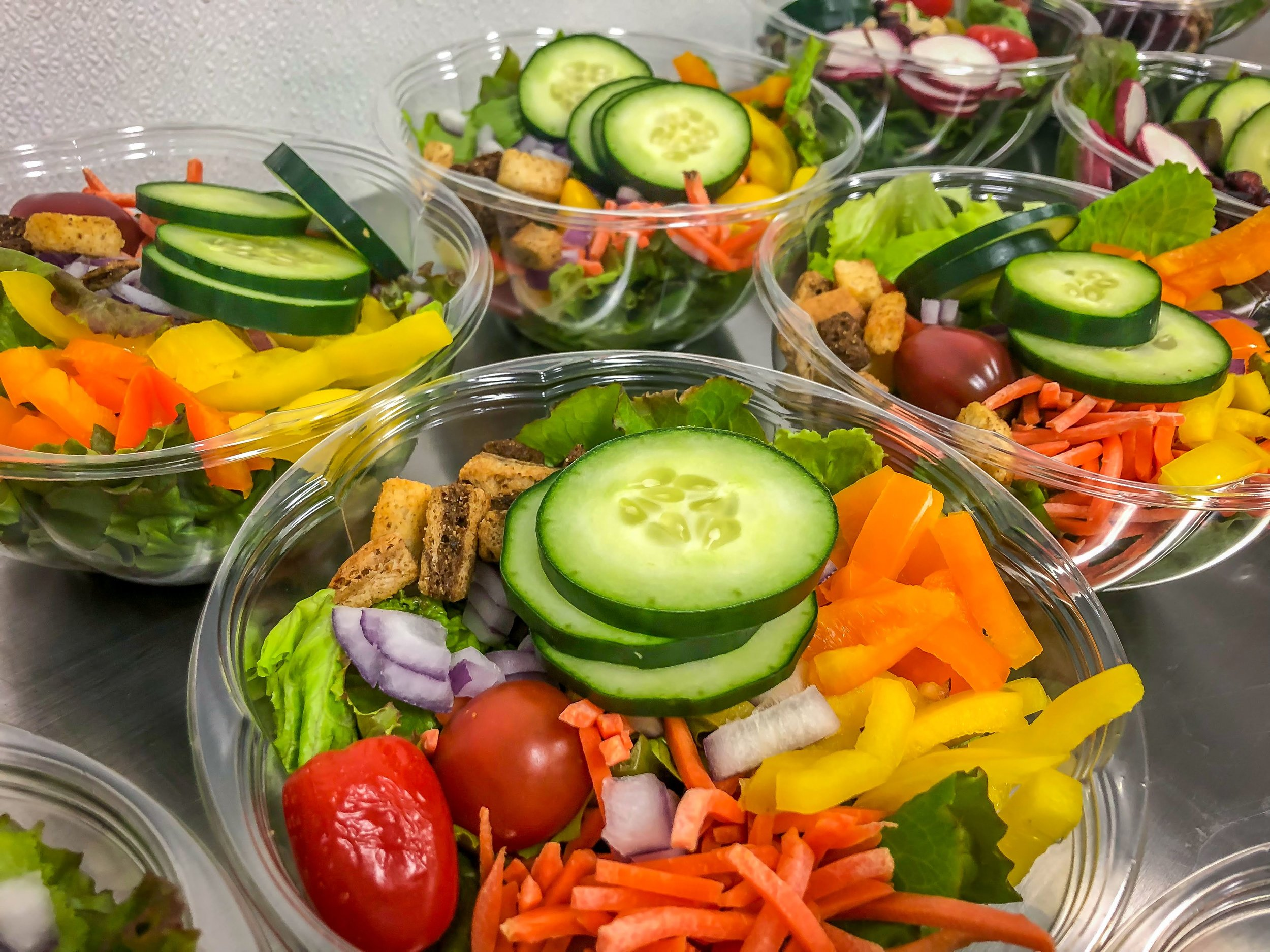 THE GARDEN   Our specialty greens mix, topped with plum tomatoes, yellow and orange bell peppers, cucumber, red onion, carrots, and croutons. Protein and homemade dressings available.