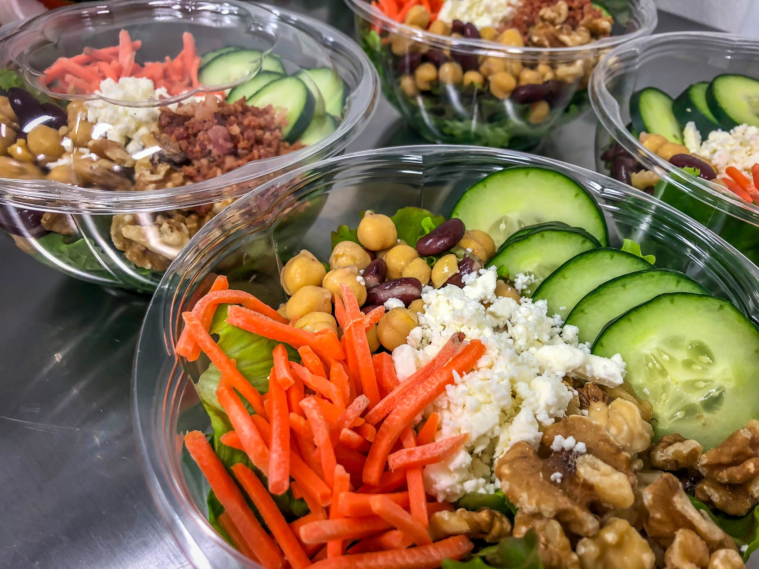 THE WEEKLYHARVEST   A fresh, crisp lettuce mix grown on our farm in Meriden, CT, paired with cucumber. our homemade bean medley (red and garbanzo beans), carrots, chopped walnuts, and feta cheese. Protein and homemade dressings available.