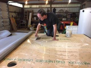 John laying down epoxy adhesive