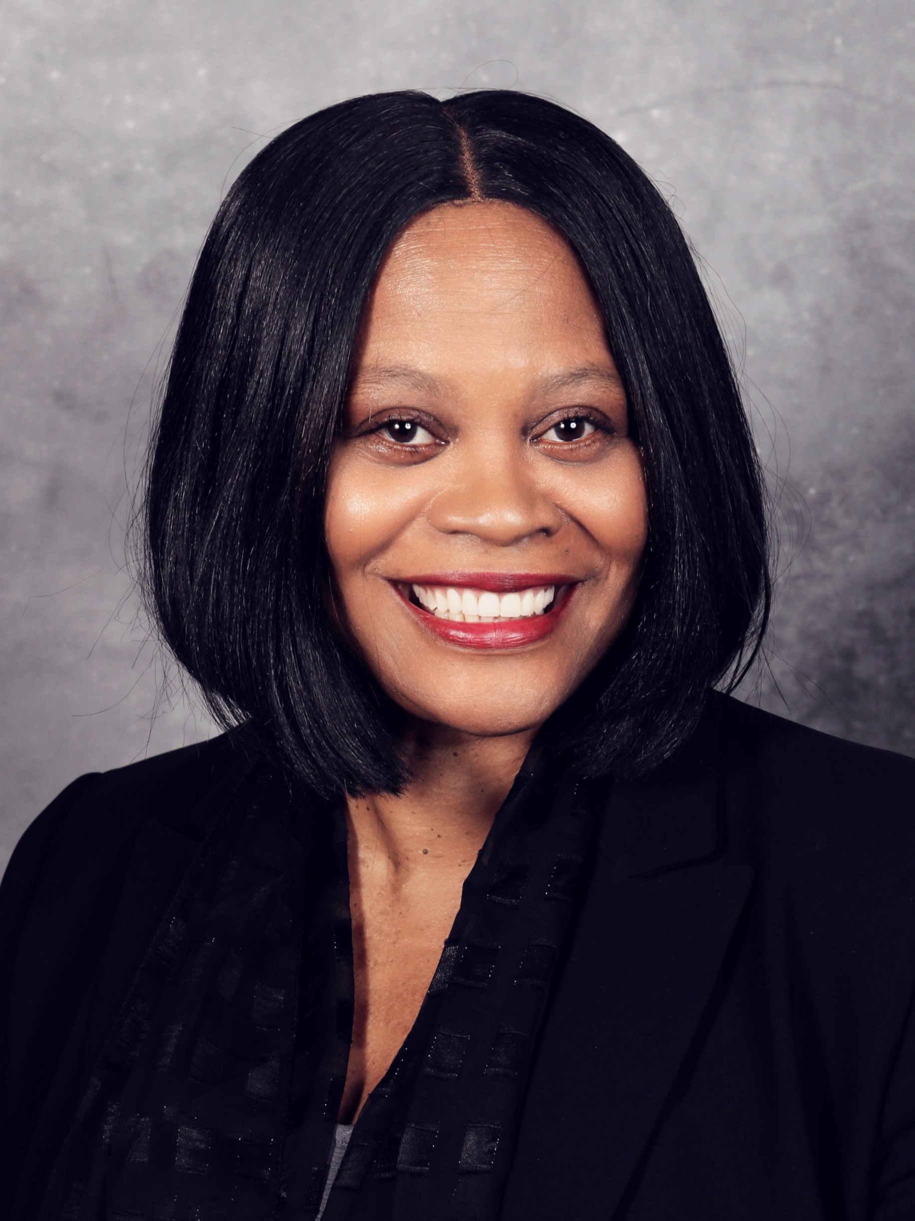 Kathy Tucker, COO - BS, MBA, MAT