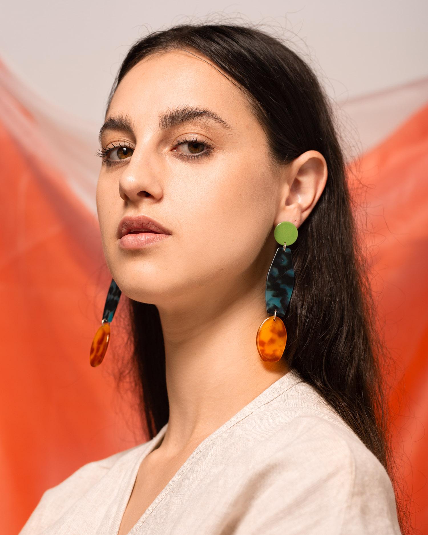 Jessie wears the  Alta Earrings in Kiwi