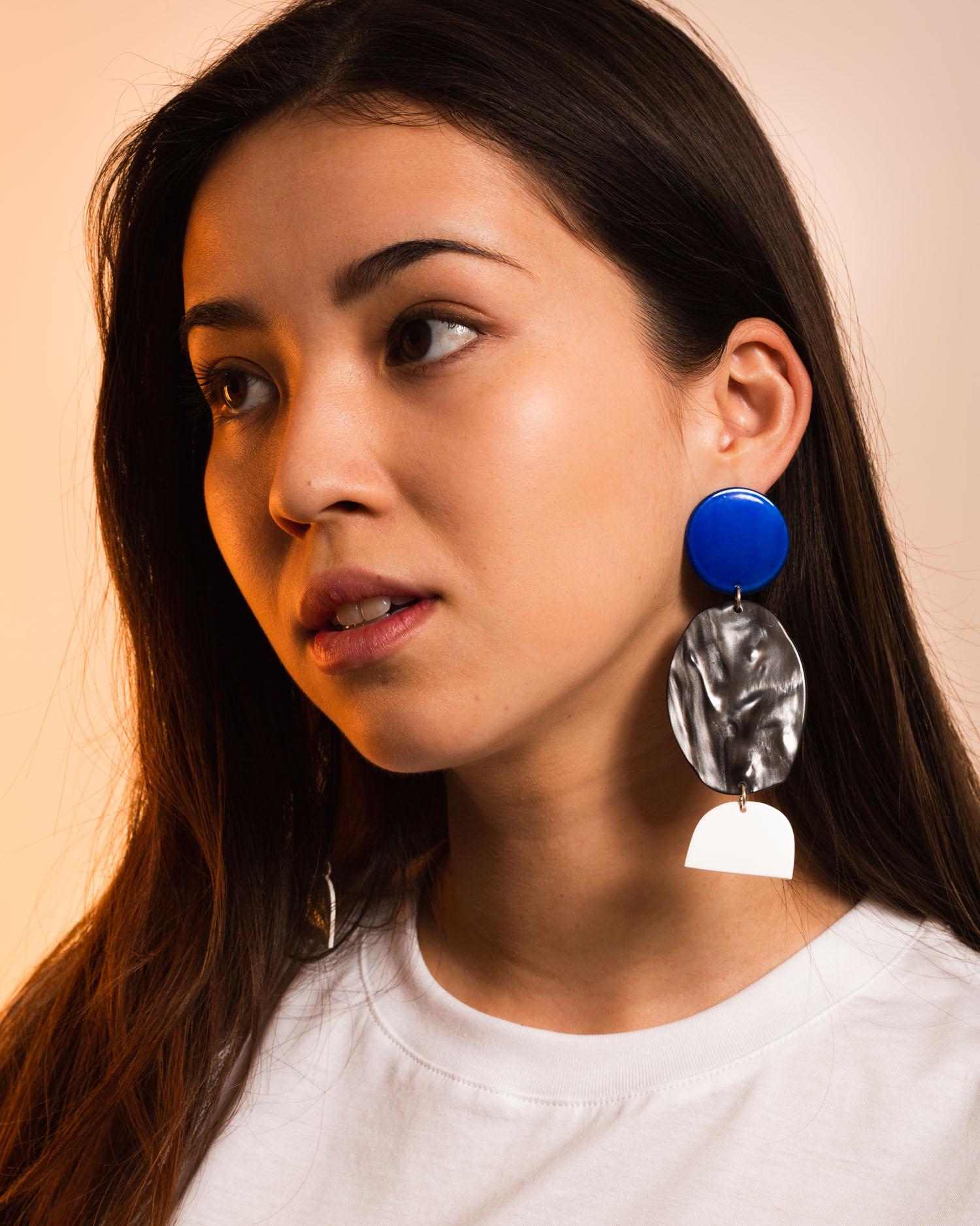 Lisa wears the  Rock Earrings in Azure Chrome