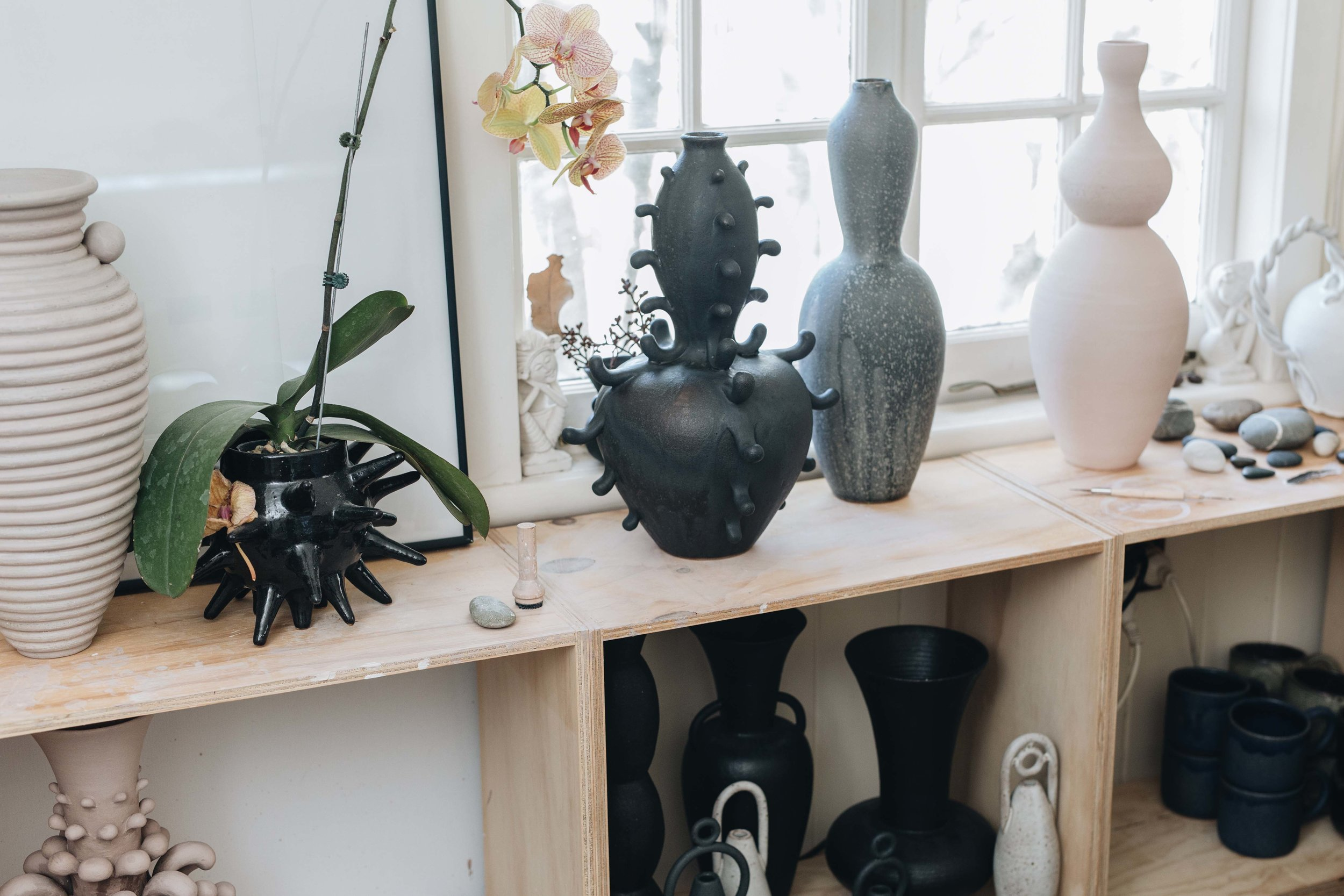 Shelves full of vessels in Nicolette's home studio