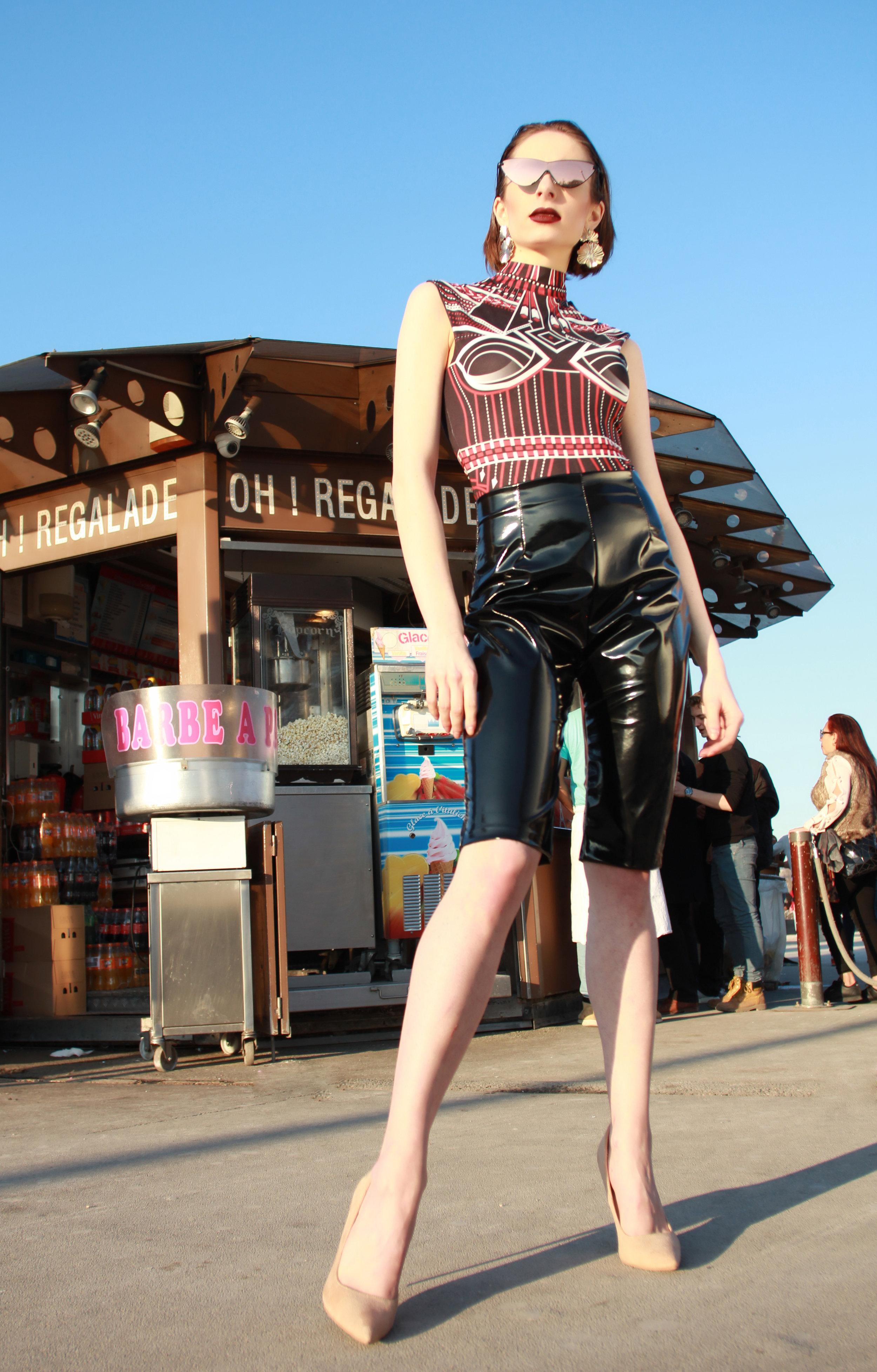 Bodysuit : L'Immortel Couture Paris  Shorts : « The Lysippé », Moira Cristescu  Heels : Louboutin  Sunglasses : Persol