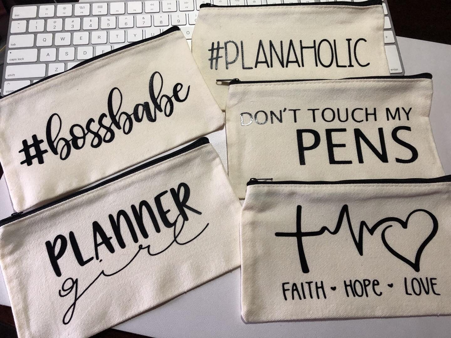 Coming Soon! These pretty babies will be available in my shop very soon so be in the lookout. . . . #penpouch #pens #plannergirl #bossbabe #pens #mildliners #planaholoc #faith #hope #love #bags #kraftyplanner