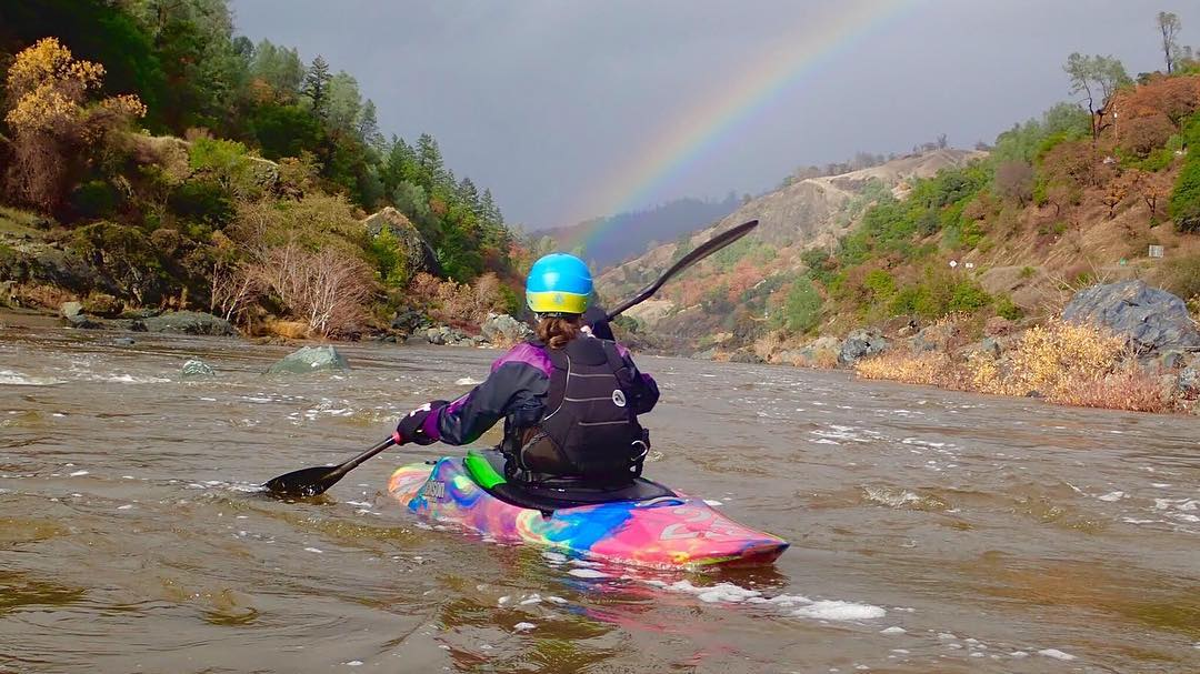 Rainbow over a whitewater kayaker on Mendcoino County's Eel River. Photo courtesy of Liquid Fusion Kayaking.