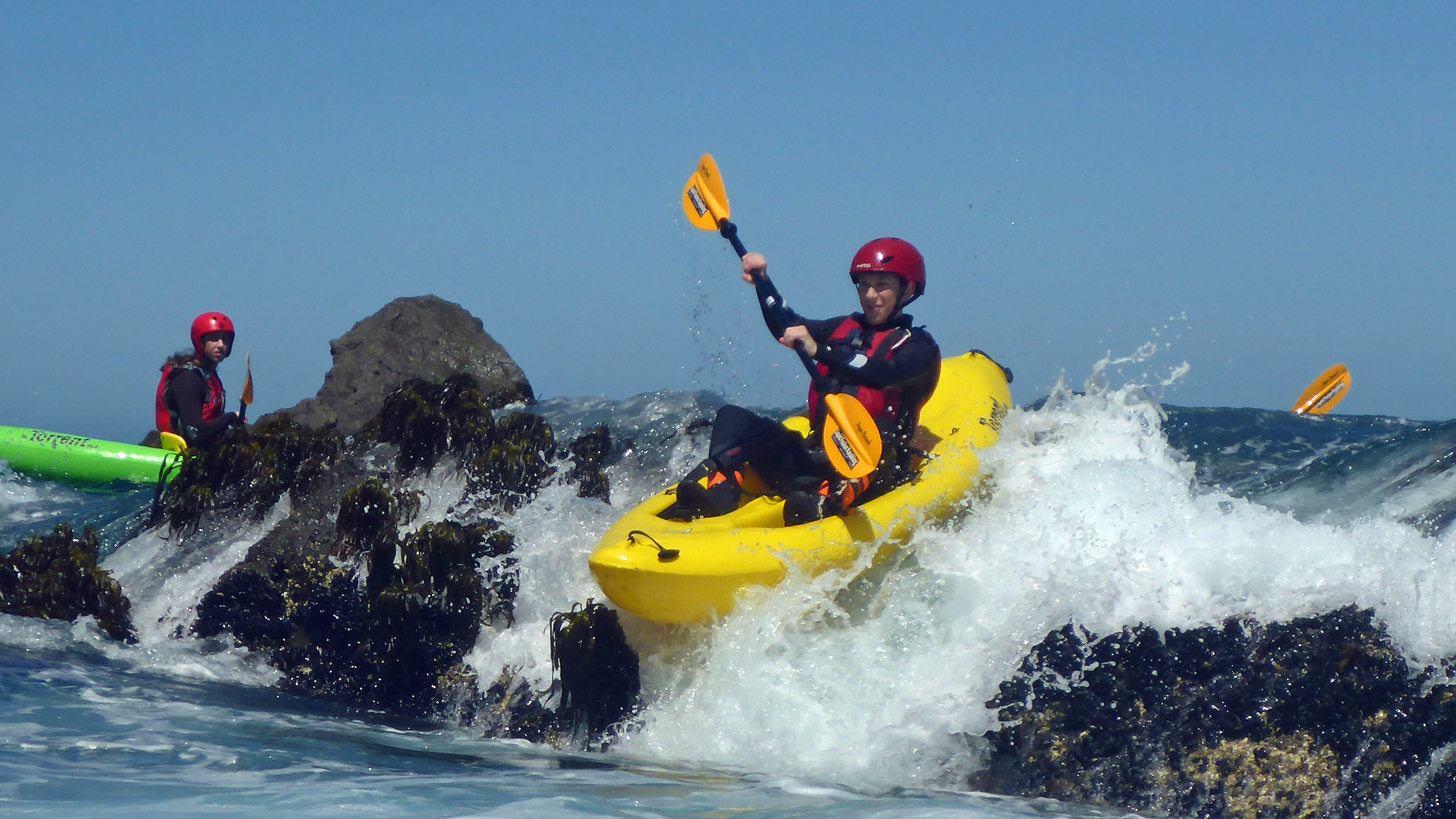 Whitewater ocean kayaking aka rock gardening on the Mendocino Coast of California. Photo Liquid Fusion Kayaking