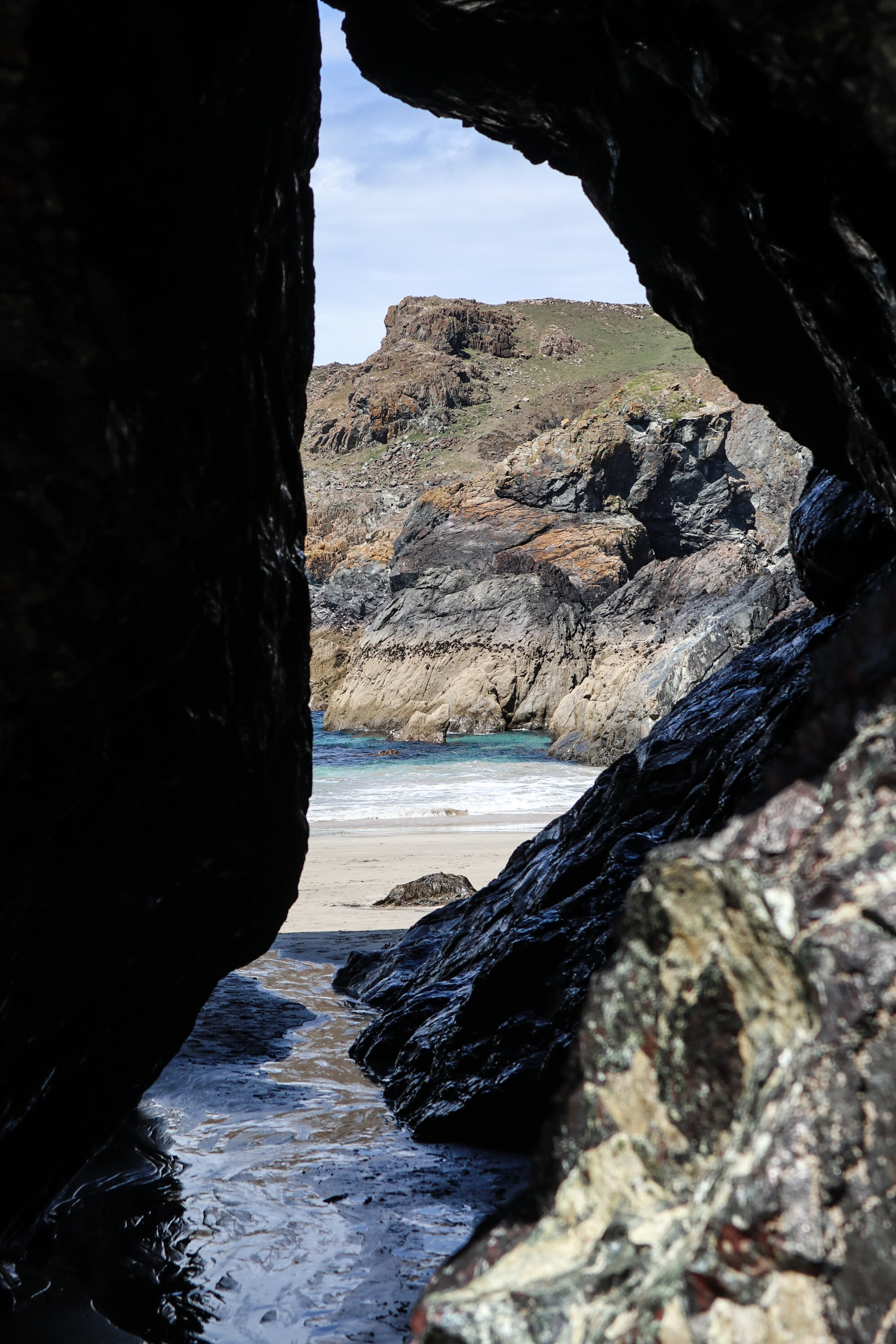 caves at kynance cove in cornwall