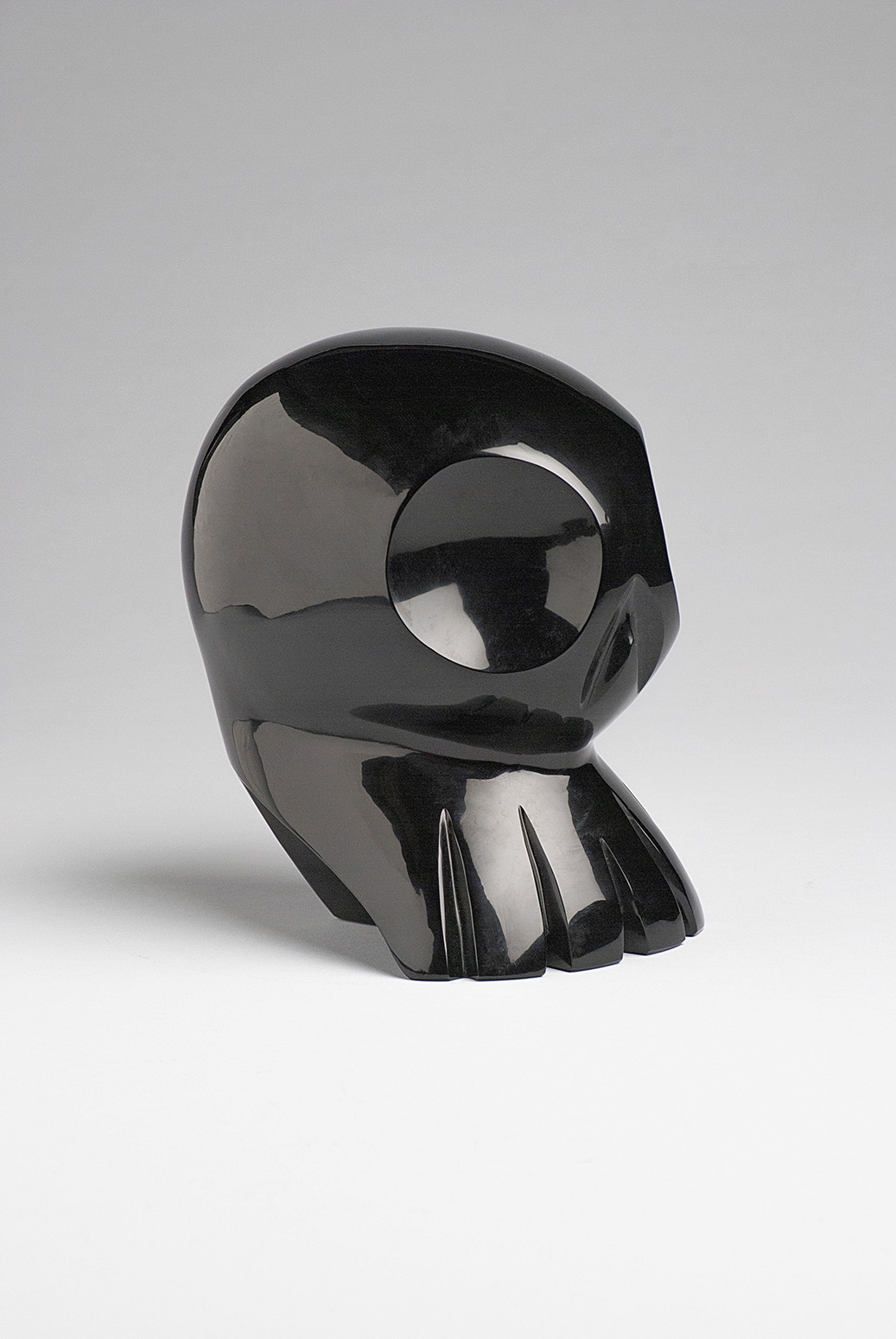 Alien, Obsidian sculpture referencing mexican skull