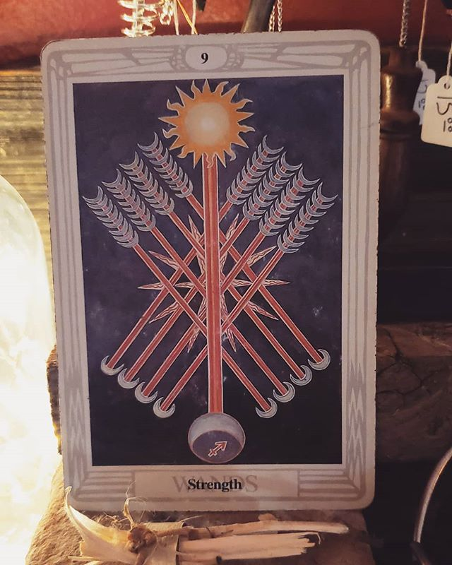 """The Nine of Swords  Well-Dignified  The Nine of Wands is the card that showed me that tarot cards work, because of that experience, and also because it represents the moon in Sagittarius which is my moon sign, this is my favorite card. It is called Strength, which probably isn't the first word you think of when you think about the ever-changing moon, and the mutable sign of Sagittarius, but it has its own kind of strength. It represents flexibility and adaptability. Which is stronger, an oak tree, or a palm tree? The oak, right? What about during a hurricane? That is the strength of the Nine of Wands. It bends, it adapts to changes, and it survives. This is a fire card, it represents our spirits, our souls, so it is flexibility on a deep level, an openness to newness and adventure, a seemingly chaotic but ultimately opportunistic approach to life. It is looking for the next step on your path everywhere and anywhere; it is being attached to nothing so that you might do anything. It is freedom in the purest sense. The wheels of life are always turning, and this card represents balancing on the top of the wheel; staying in motion keeps you on top, or as Crowley puts it, """"change is stability"""". Ill-Dignified If it is near a lot of water cards this can show rigidity or clinging to current circumstances. An unwillingness to change due to fear, or arrogance, which is the shadow side of the whole Wands suit.  #eyebrightandrue #thothtarot #aleistercrowley #friedaharris #tarot #tarotcards #tarotreadings #tarotforspiritualgrowth #nineofwands #strength #thesuitoffire #thesuitofspirit"""