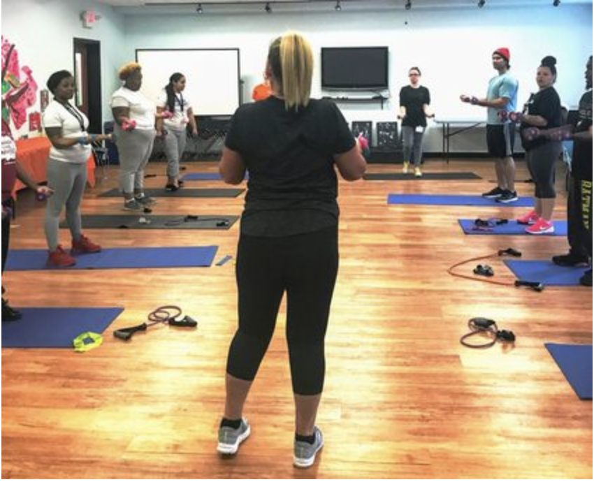 Center residents take part in a weekly fitness class as part of the new fitness incentive program.