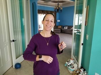 Jodie displays her new Versa on her wrist while showing off the Fitbit One she'll be sending to RecycleHealth.   Click here to read more about Jodie's Donation.