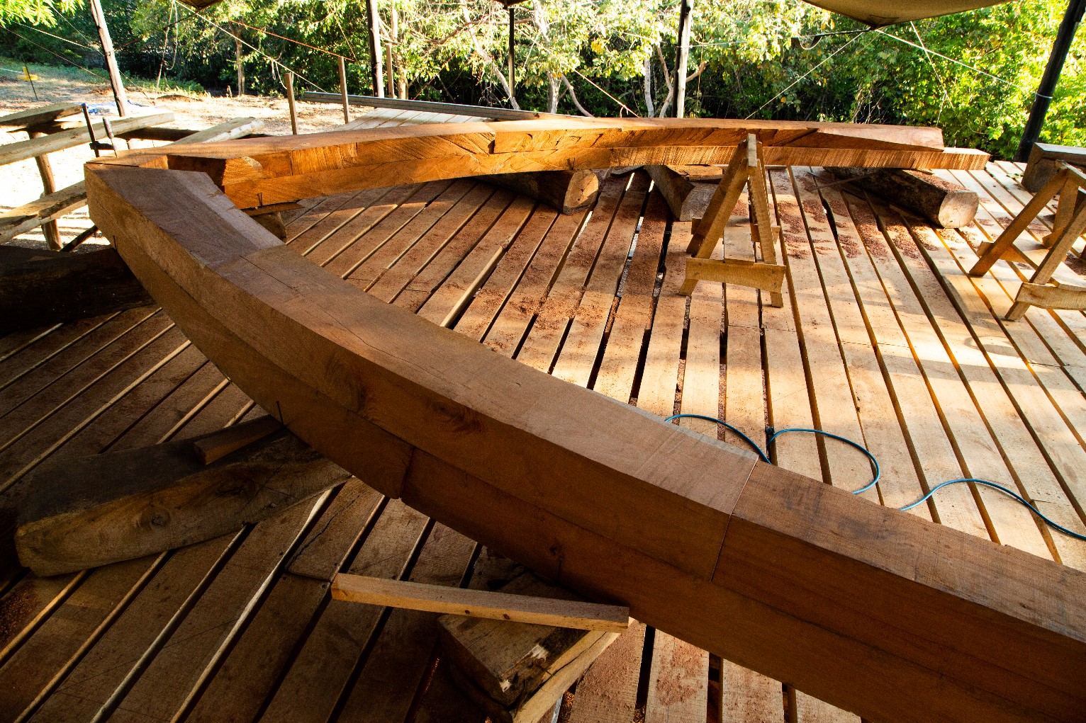 Framing tallship  Ceiba  at Astillero Verde . This framing deck is built of all local Cypress trees, and the frame itself is of sustinably-sourced Spanish Cedar.    Photo: Jeremy Starn.