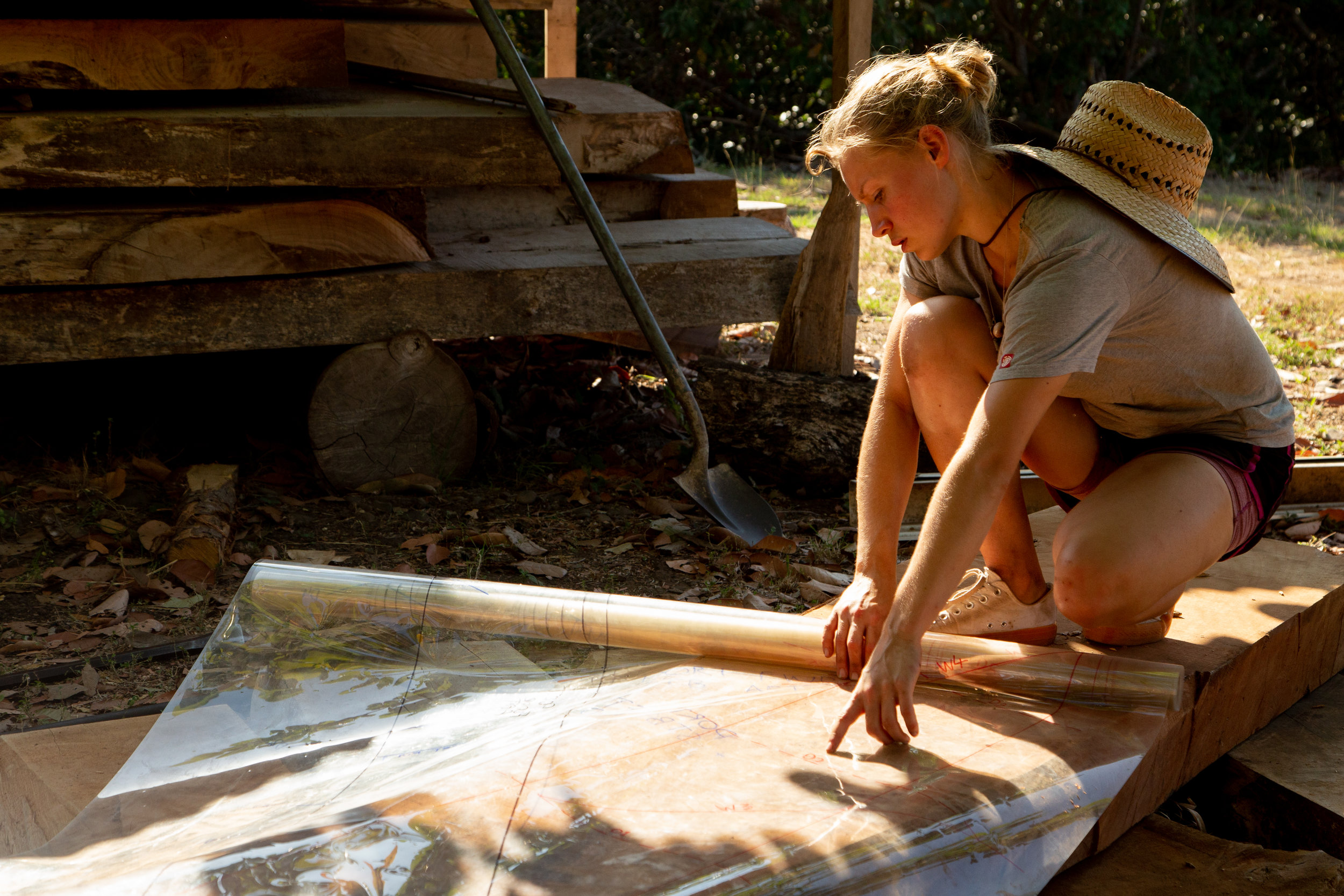 Trained wooden boat builder Connie reads a template for frame number 48 of the large wooden ship,  Ceiba .    Photo: Jeremy Starn.