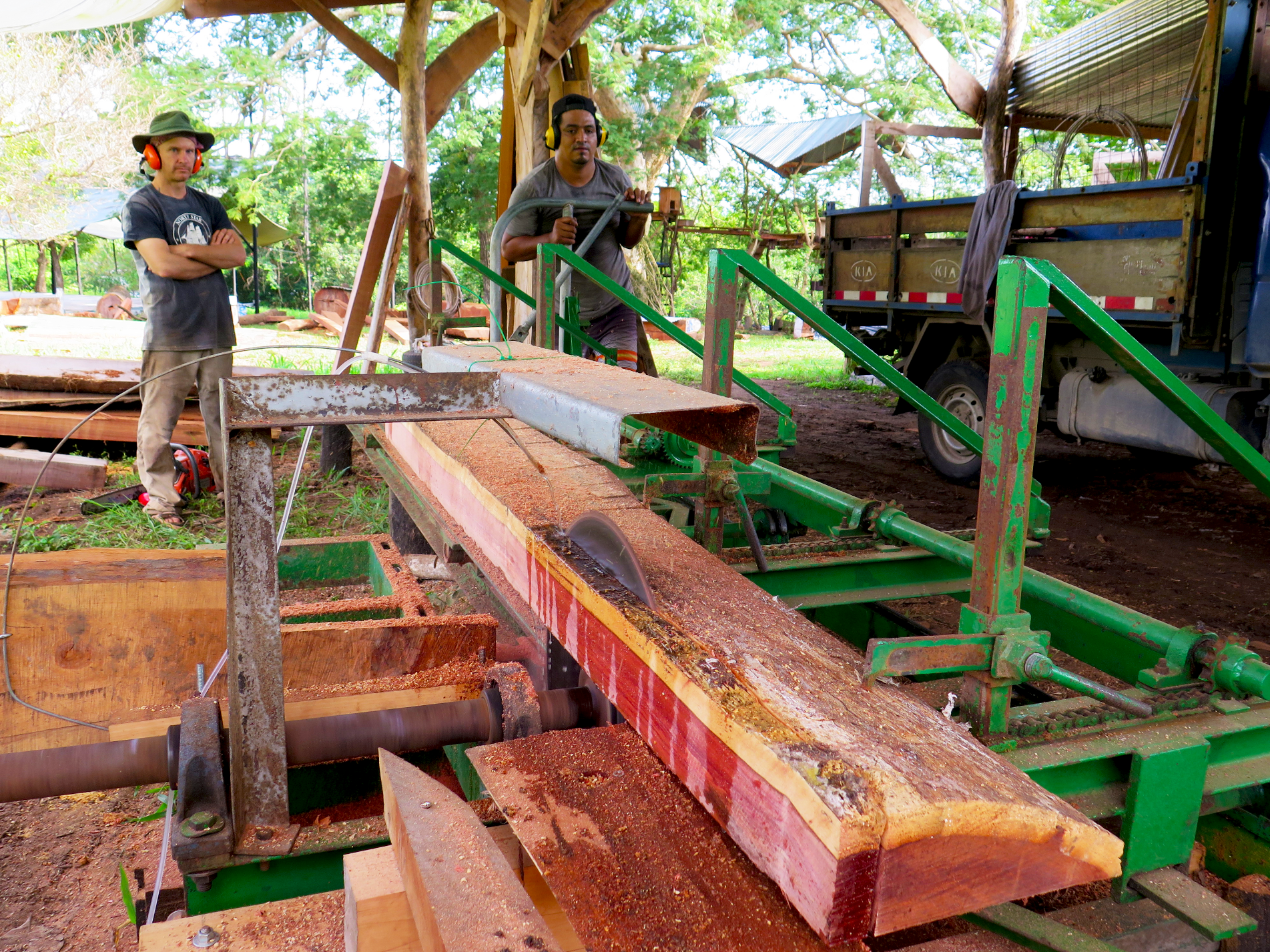 Lynx and Francisco work the fixed-blade sawmill, which is capable of ripping the densest hardwoods in the world. Shown on the sawmill is Tamarindo del Monte (Latin:  dialium guianese ), which was naturally wind-fallen by Hurricane Otto in Bijagua, Northern Costa Rica.  Photo: Danielle Doggett.