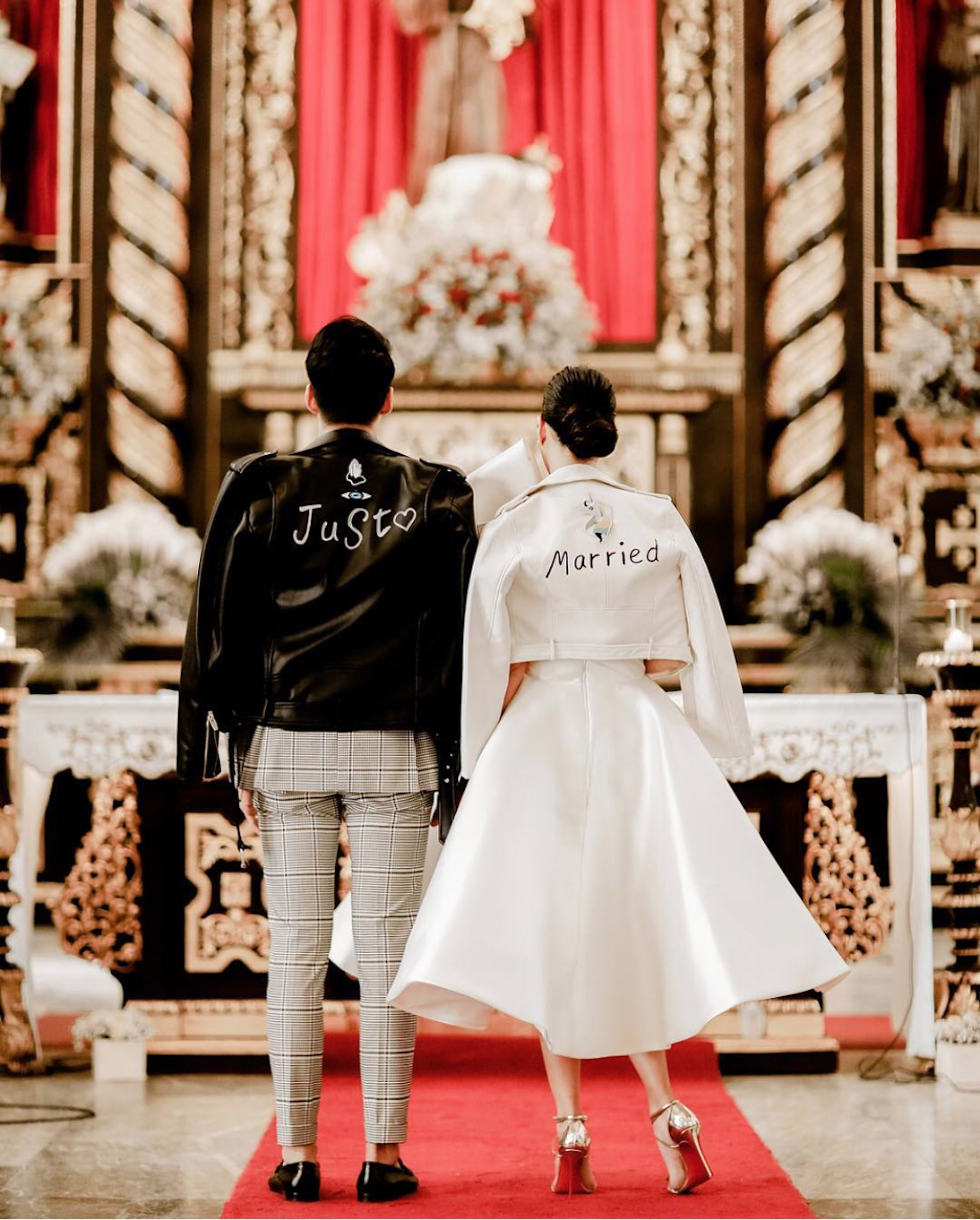 Bride's dress by Mark Bumgarner. Leather jackets styled by groomRob Mananquil. - Photo by Proud Rad