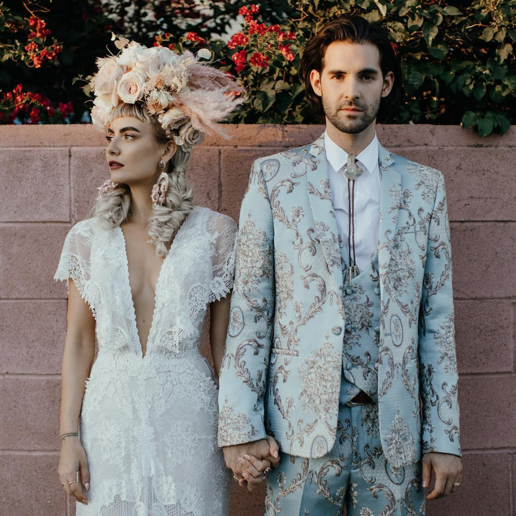 Mad Maven wears Galia Lahav, Mark wears ASOS. Floral headpiece by Tess Made. - Nikia AKA Mad Maven Style and hubby Mark Daoust redefined bridal fashion with bold prints and dramatic headpieces.Photo by Sara K. Byrne and Phil Chester.