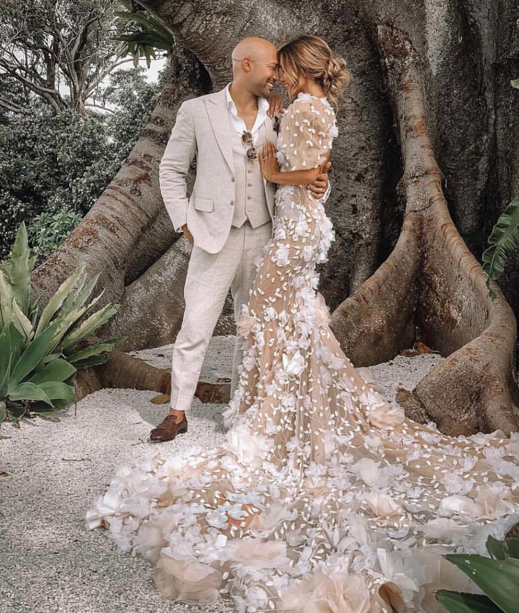 Bold is beautiful! Bride Pia Muehlenbeck opted for a Pallas Couture gown that rivaled Mother Nature herself. - The appliques and natural tones of this custom gown was truly a work of art.Photo by Rachel B. Sharp.