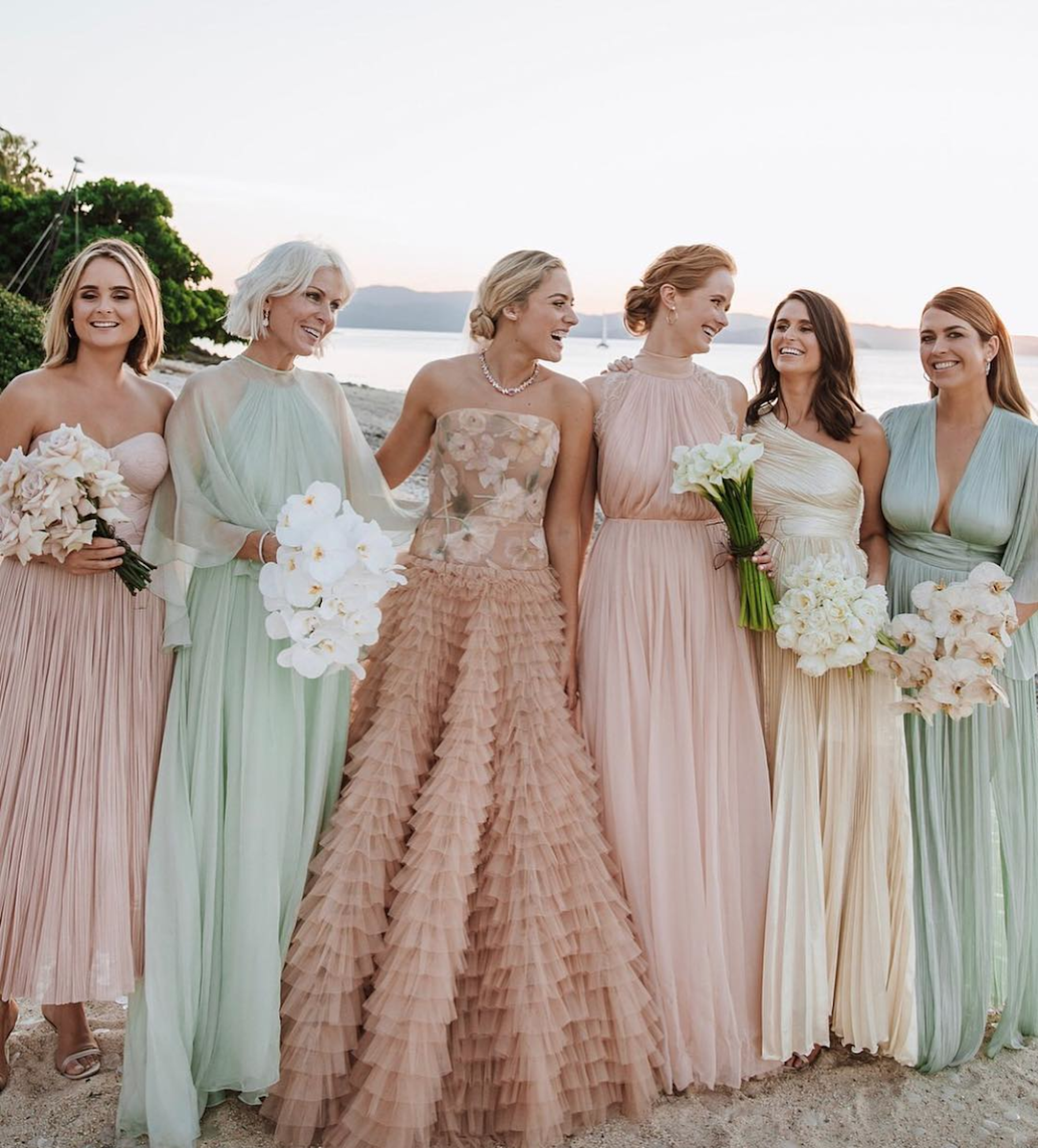 Deborah Symond served unconventional bridal beauty in a pastel Dior gown complete with a ruffled skirt and floral bodice. - Her bridesmaids coordinated perfectly with an assortment of sorbet colored dresses.Photo by Alice Mahran.