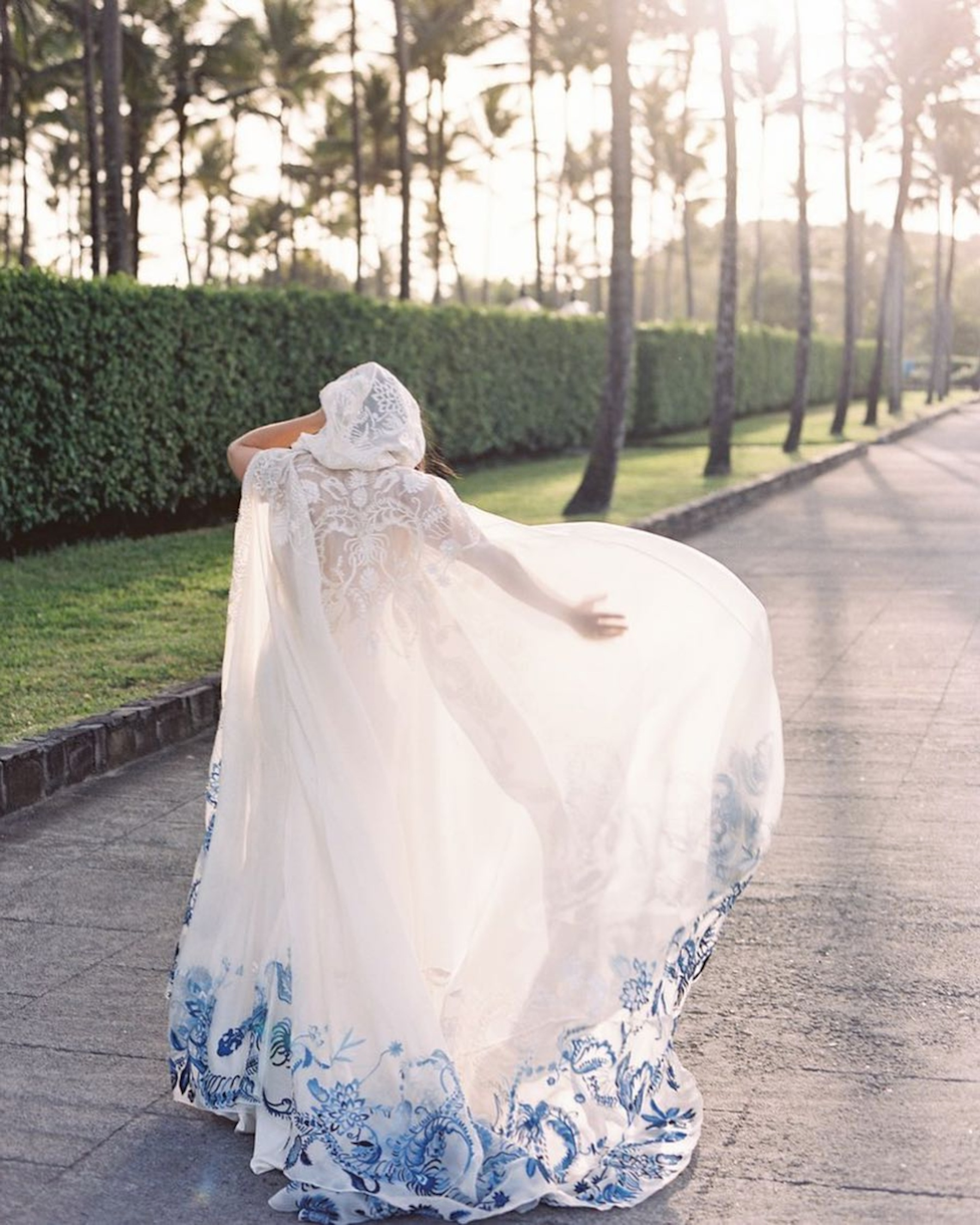 Tommy Hilfiger heiress Ally Hilfiger had the rock and roll beach wedding of her dreams. - The bride and designer teamed up with dad to create this gorgeous hand embroidered cape. Stunning!Photo by Tec Petaja.