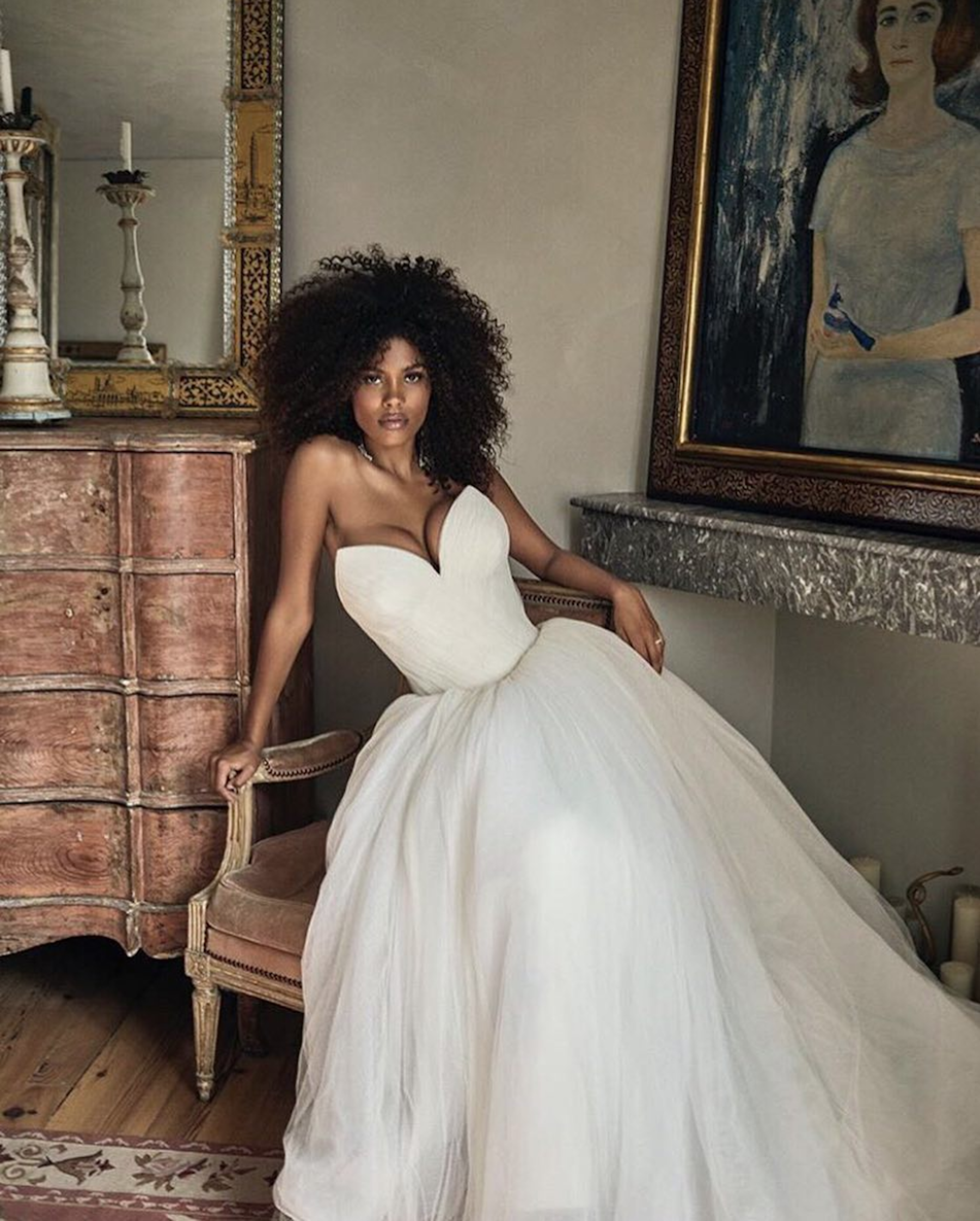 """Model Tina Kunakey said """"I do"""" to long-time beau and actor Vincent Cassel in custom Vera Wang. - """"This gown is all about youth, charm, and couture draping with a voluminous ballskirt,"""" said Wang.Photo by Victor Santiago."""