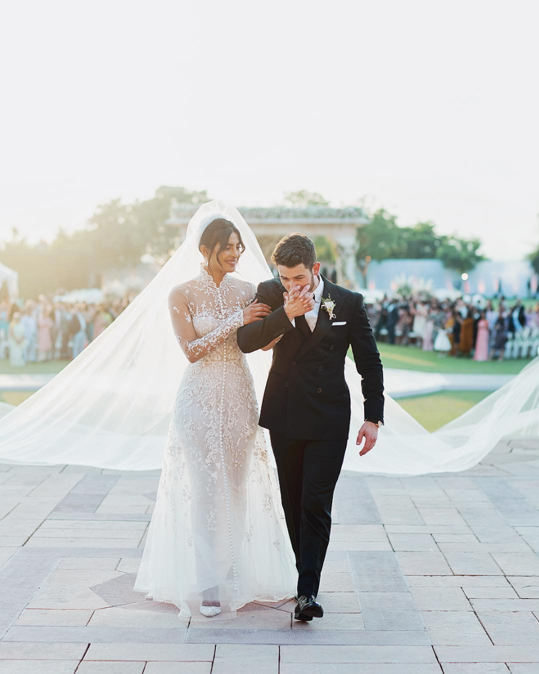 Nick Jonas and Priyanka Chopra in custom Ralph Lauren. - They technically aren't of royal blood but their wedding definitely garnered just as much media attention. A pretty big deal considering the American designer has only designer bridal gowns for his daughter, daughter-in-law, and niece. Priyanka's 75-foot tulle veil was also a show-stopper as it took several guests to carry it down the aisle.