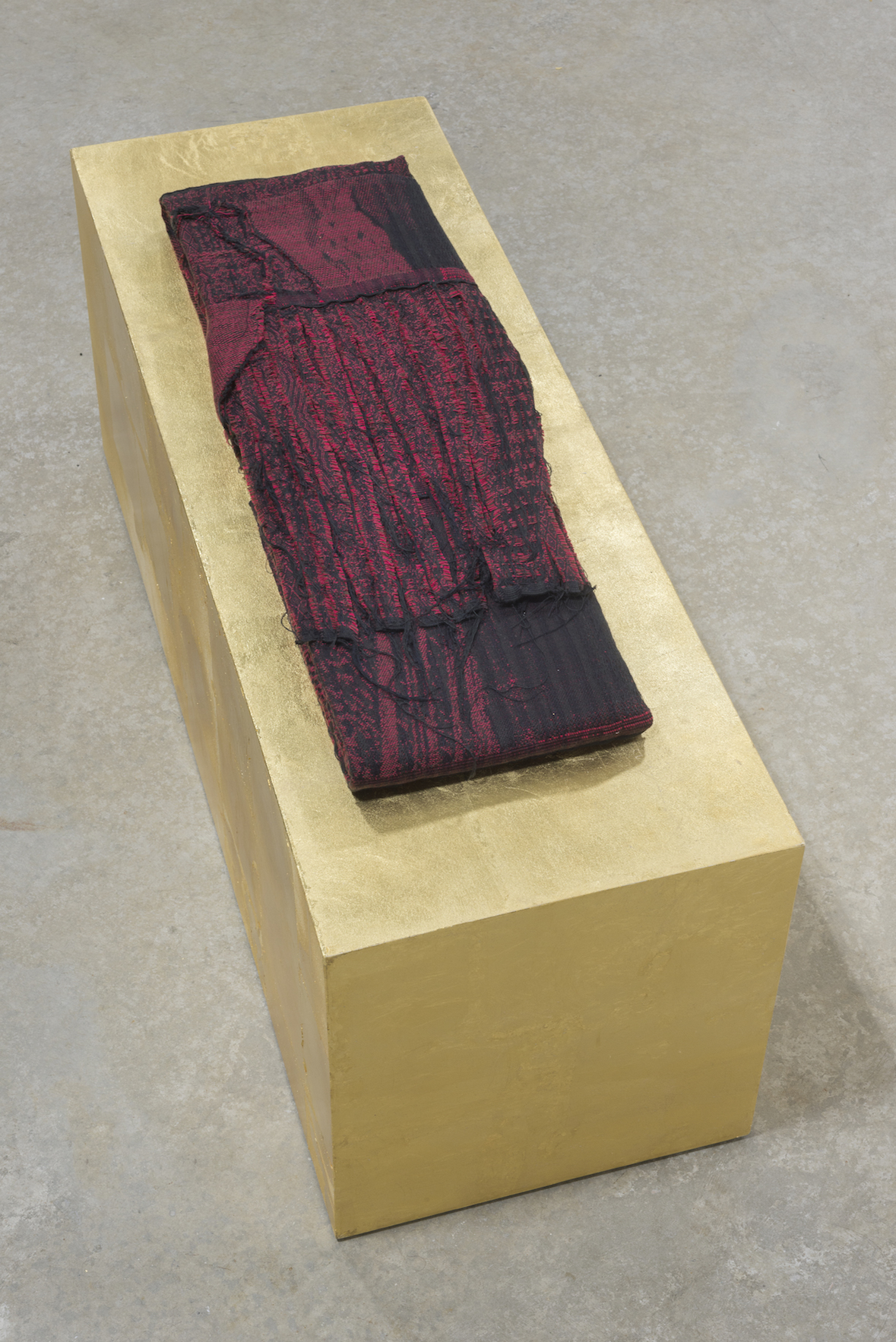 "Sacred Cloth I  (cloth folded) 11"" X 26"" (pedestal) 13"" X 36"" X 14,"" 2017, cotton, gold-leaf, & wood"
