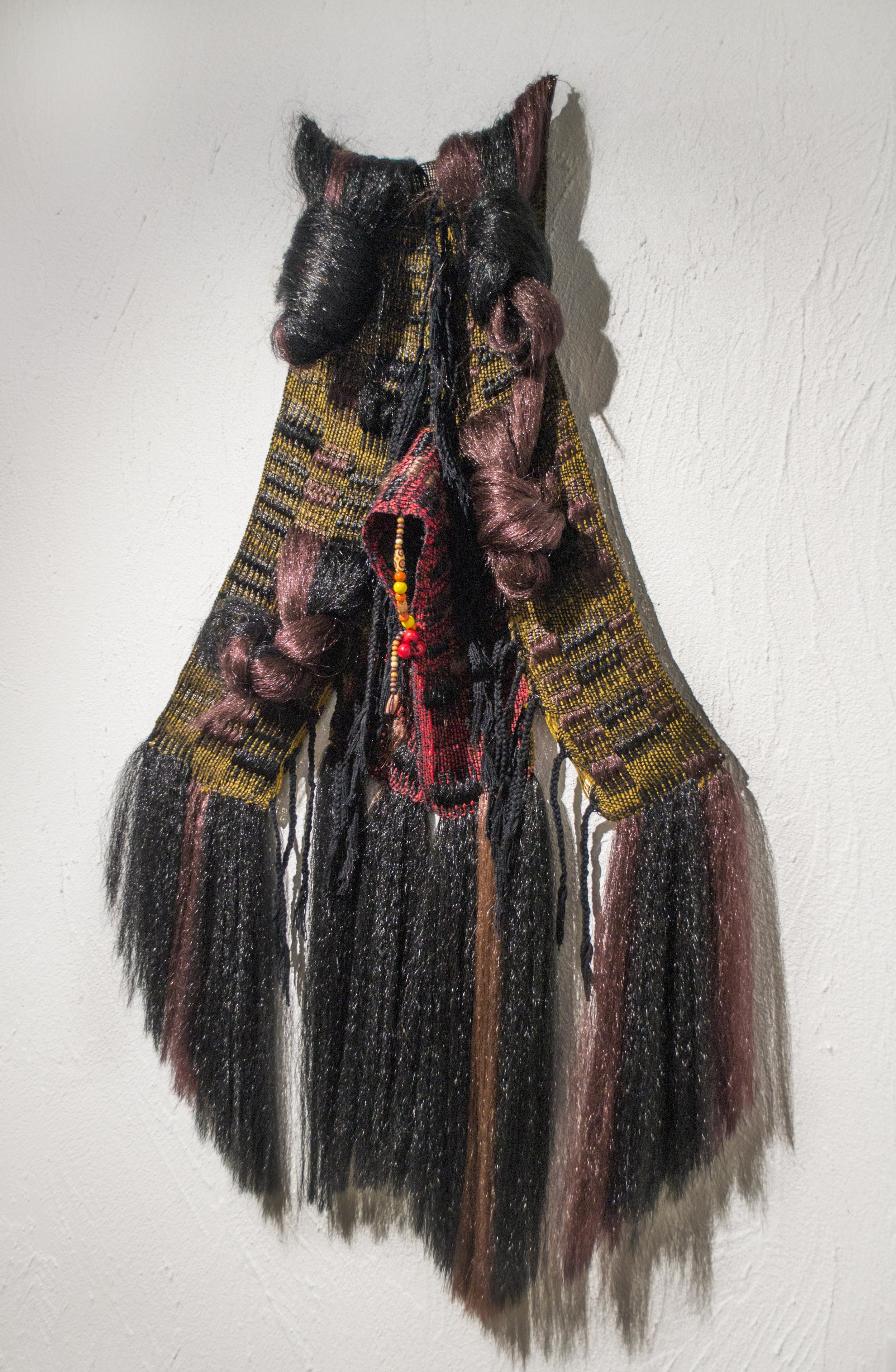 Rec-Triangular Cut  2014, Cotton, yarn, wooden beads, and synthetic hair, Photographer: Sylvia Abisaab SOLD