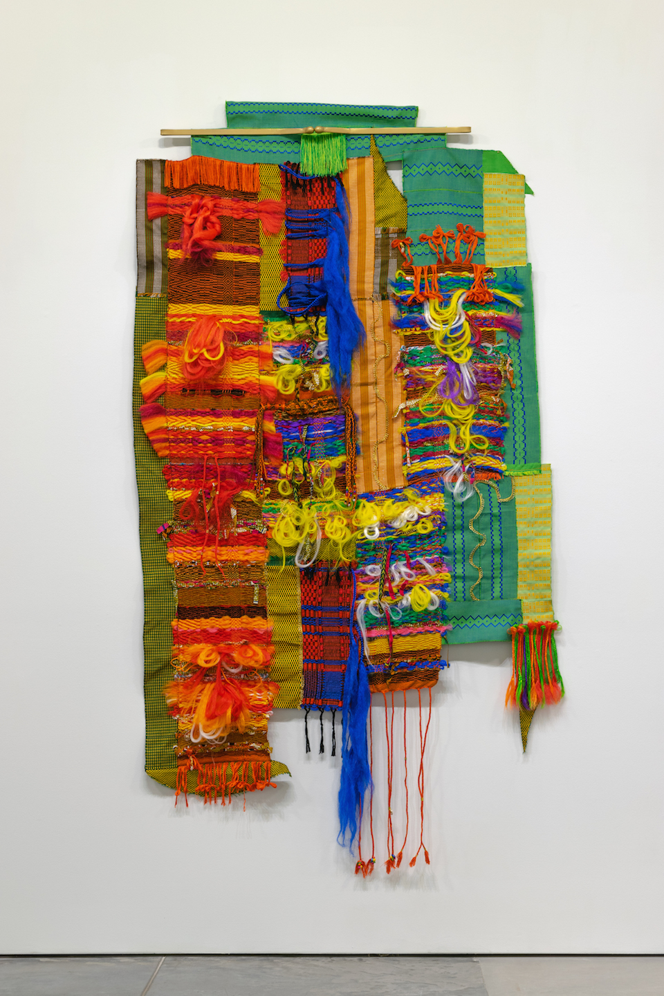 """It's Kharnaval  2019, 51"""" (W) X 101"""" (L), Synthetic-hair, cotton, hitarget (GH) fabric, rayon, wool, linen, polyester, hair accessories, metal, & spray paint. Photographer: Zane Smith courtesy of Haw Contemporary"""