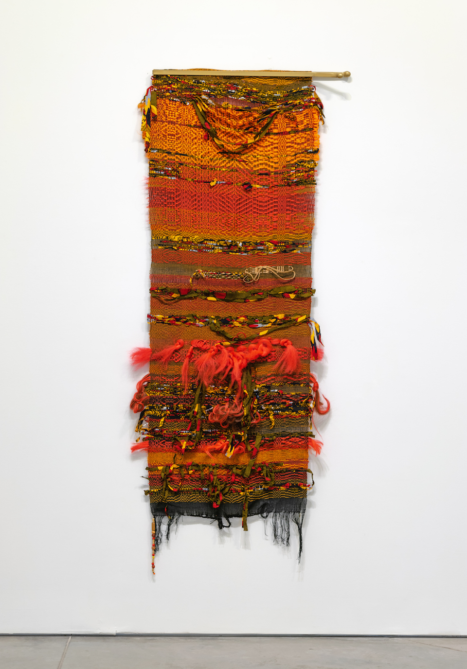 """Sun Hot  2019, 28"""" (W) X 83"""" (L), Synthetic-hair, cotton, hitarget (GH) fabric, rayon, wool, linen, wooden beads, metal & spray paint. Photographer: Zane Smith courtesy of Haw Contemporary"""