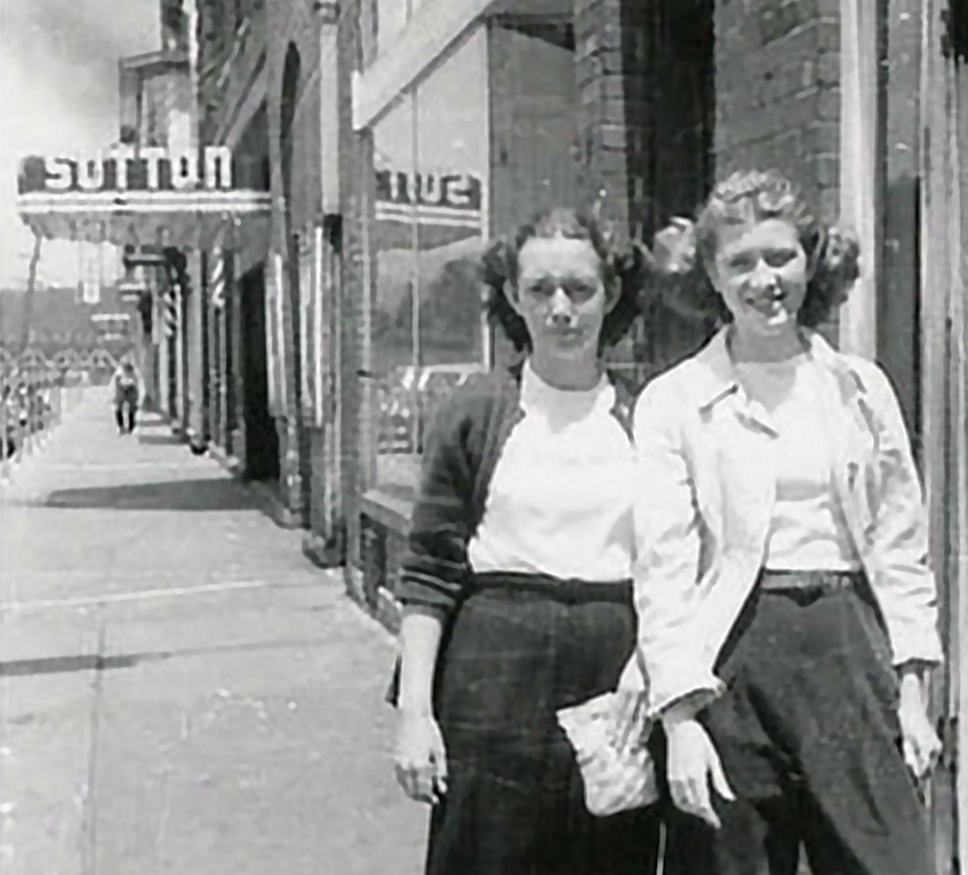 Local residents outside Sutton Theater in Thomas. Note the marquee in the background (the marquee has been placed into storage for potential future restoration and reuse).