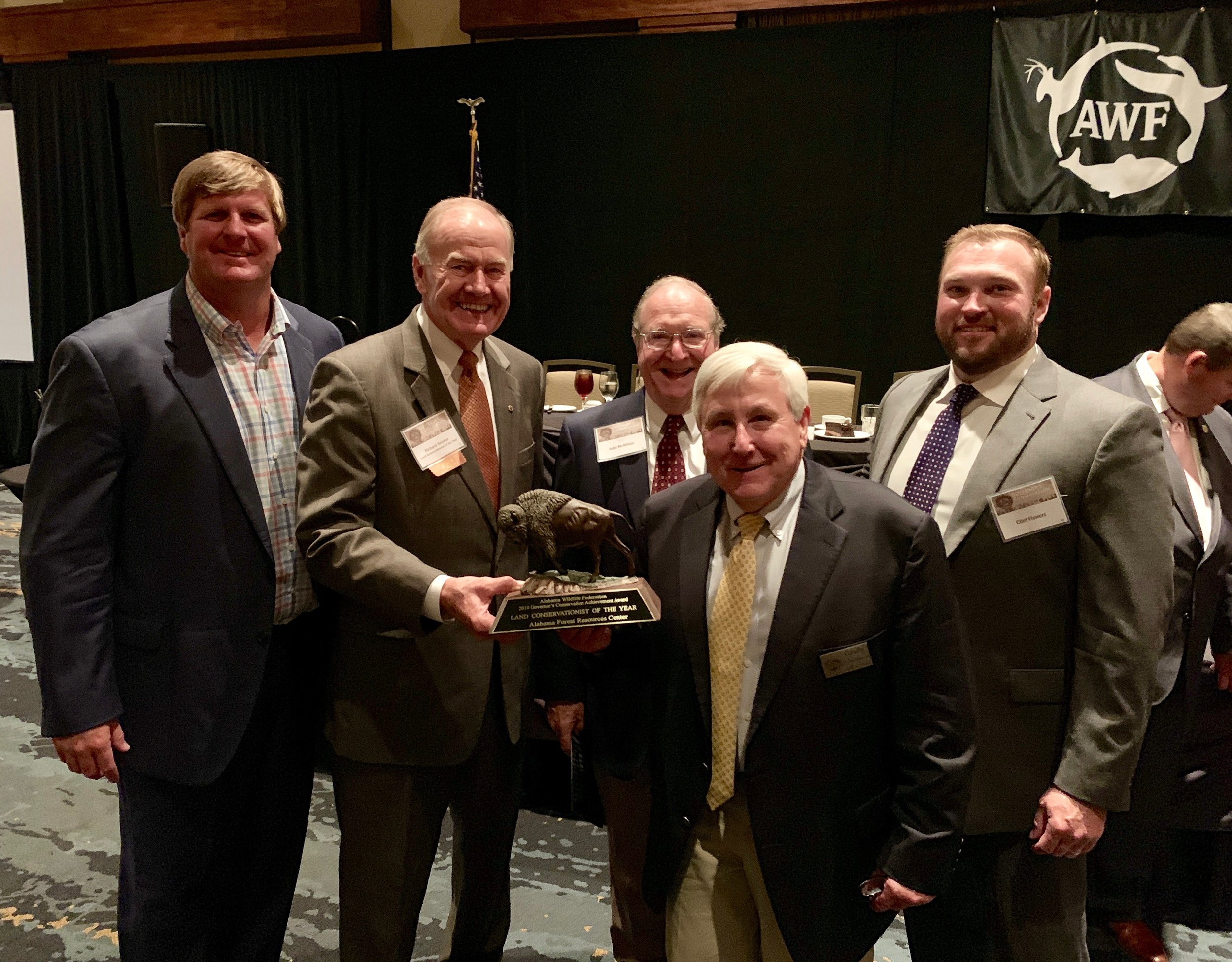Board members (L-R) Michael Delaney, Dr. Richard Brinker, John McMillan, Grady Hartzog, and Clint Flowers receiving the 2019 Alabama Wildlife Federation's Governor's Conservation Achievement Award to AFRC for Land Conservationist of the Year