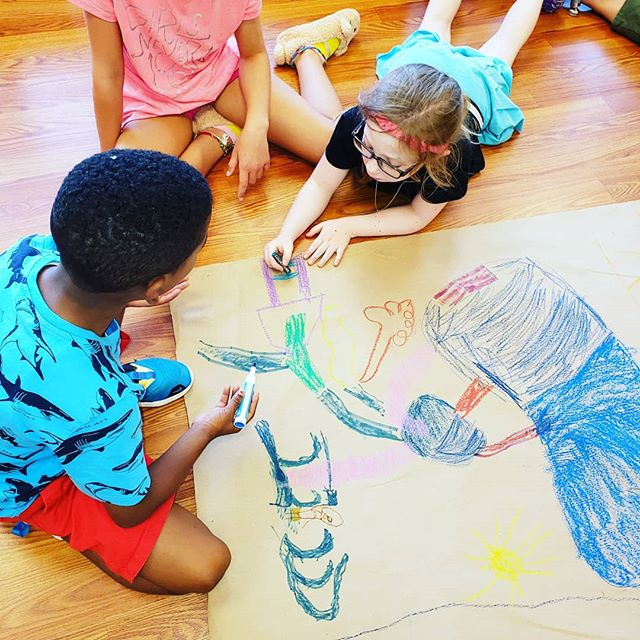 School-age group working on summer mural.