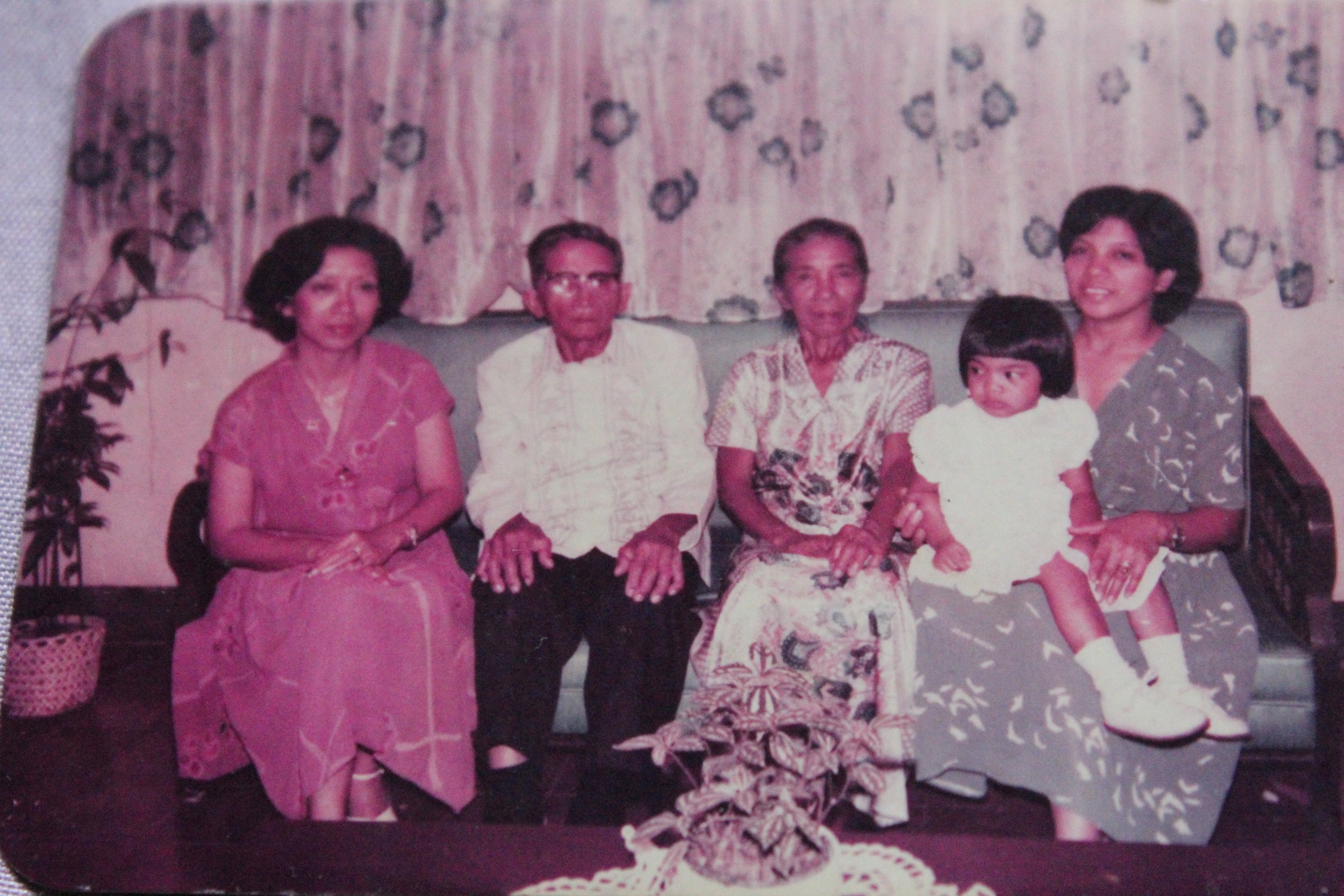 My family in the early 1980s (left to right): my aunt, Dr. Mendoza; my lolo Aniceto; my lola Maxima; my mom Corazon and me on her lap.