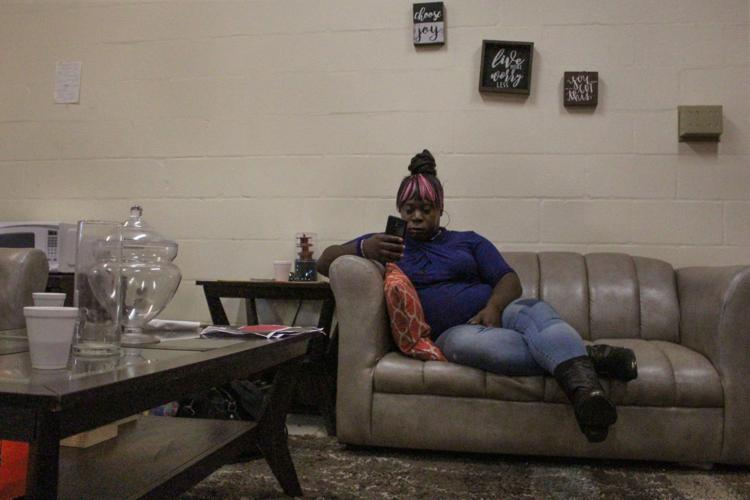 "Monica Love, 25, sits in a back room of GRACE Marketplace, a Gainesville homeless shelter. She's been in and out of GRACE for the past four years. ""It gets better but it's more of what you make it,"" Love said.  Dana Cassidy / Alligator Staff"