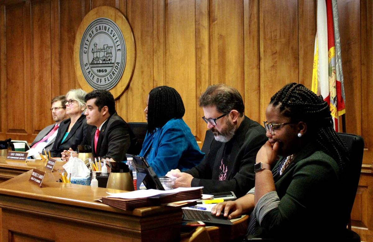 Mayor Lauren Poe and Gainesville city commissioners listen to the public's comments Thursday during the Gainesville City Commission meeting at City Hall. The meeting was over four hours long, and the panel of legislators passed legislation that banned the use of plastic bags in Gainesville.  Nicole Needles / Alligator Staff