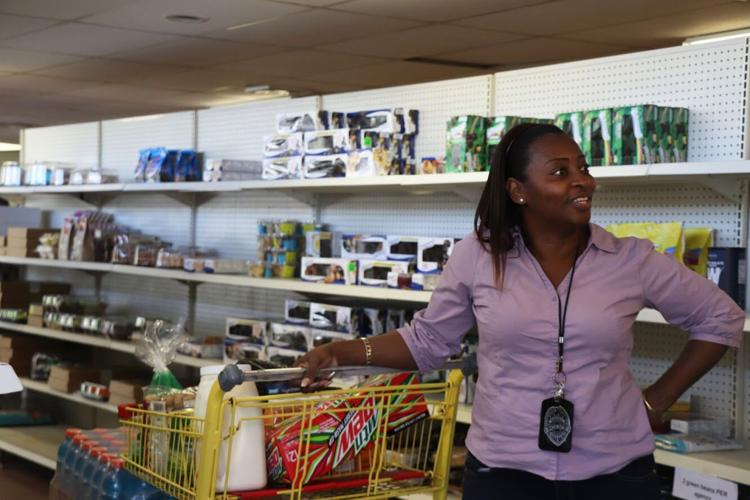 Pastor Crystal Griffin stops to talk to a friend while shopping for her ministry on Friday afternoon at the Bread of the Mighty Food Bank. The food bank distributes to five surrounding counties, including Alachua.  Kelly Hayes / Alligator Staff