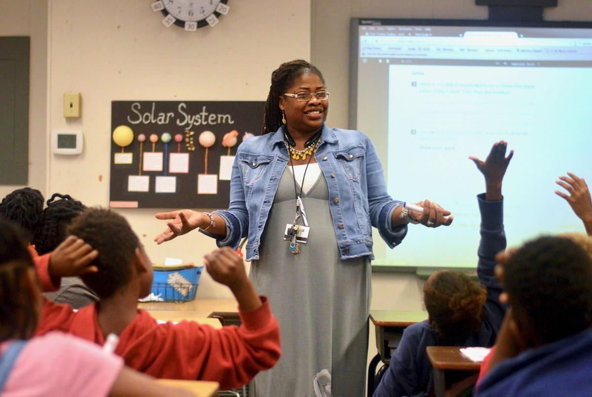 "[FILE PHOTO] 35-year-old Lilliemarie Gore leads students of Idylwild Elementary School through a series of math exercises. Mrs. Gore was awarded the title of ""2017-2018 Alachua County Teacher of the Year"" earlier this month.  Taylour Marks / Alligator Staff"