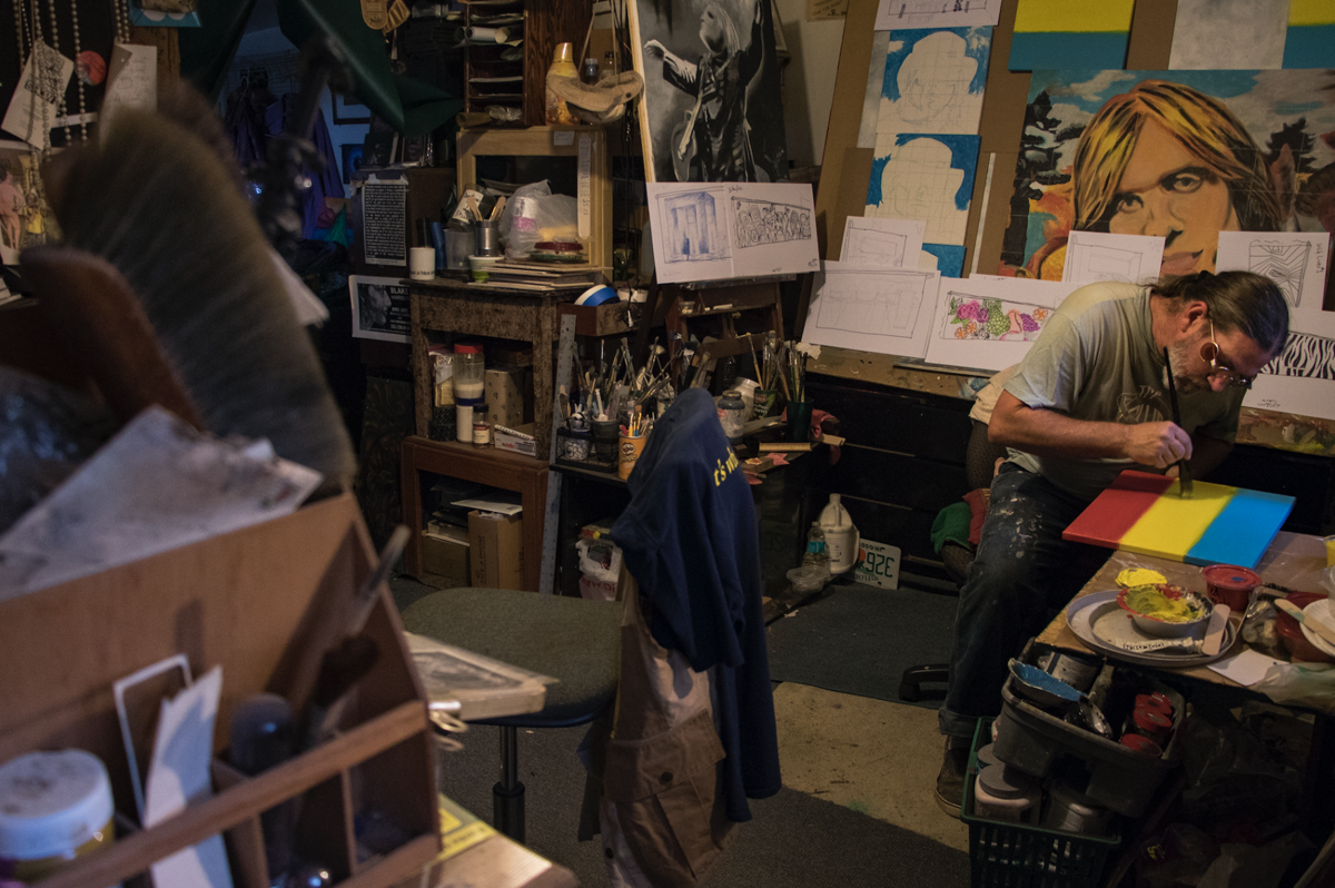 Blake Harrison touches up his artwork in his studio in Micanopy, Florida.  Aaron Ritter / Alligator Staff