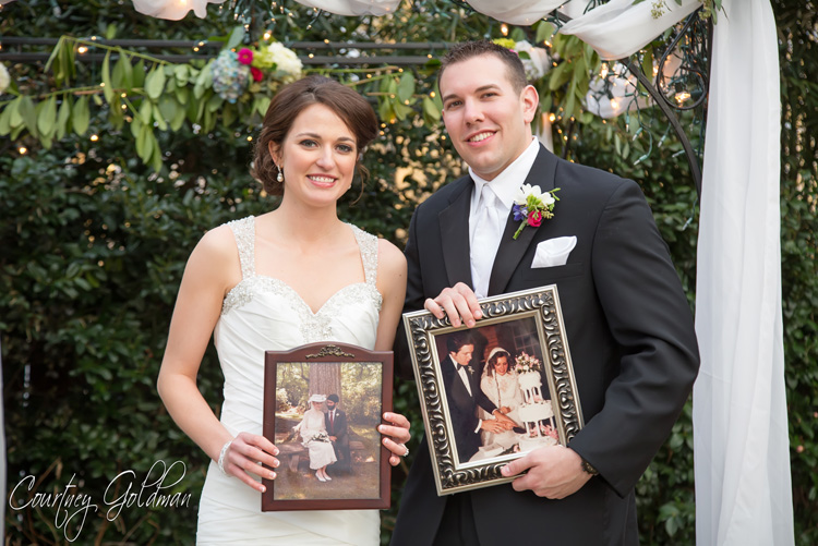 The-Thompson-House-and-Gardens-Wedding-Ceremony-in-Bogart-and-Athens-Georgia-by-Courtney-Goldman-Photography-25-Bride-and-Groom-with-their-Wedding-Photos.jpg