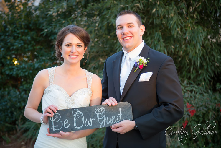 The-Thompson-House-and-Gardens-Wedding-Ceremony-in-Bogart-and-Athens-Georgia-by-Courtney-Goldman-Photography-30-Bride-and-Groom-with-Sign.jpg
