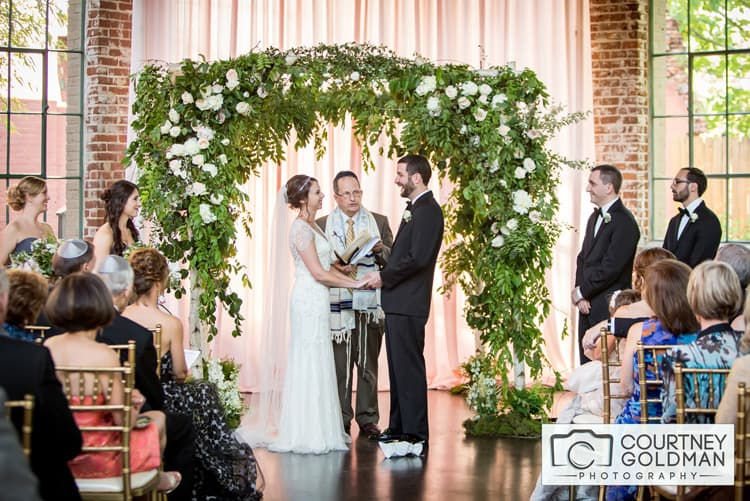 Jewish Wedding Ceremony under Floral Chuppah at The Foundry at Puritan Mill by Courtney Goldman Photography 32